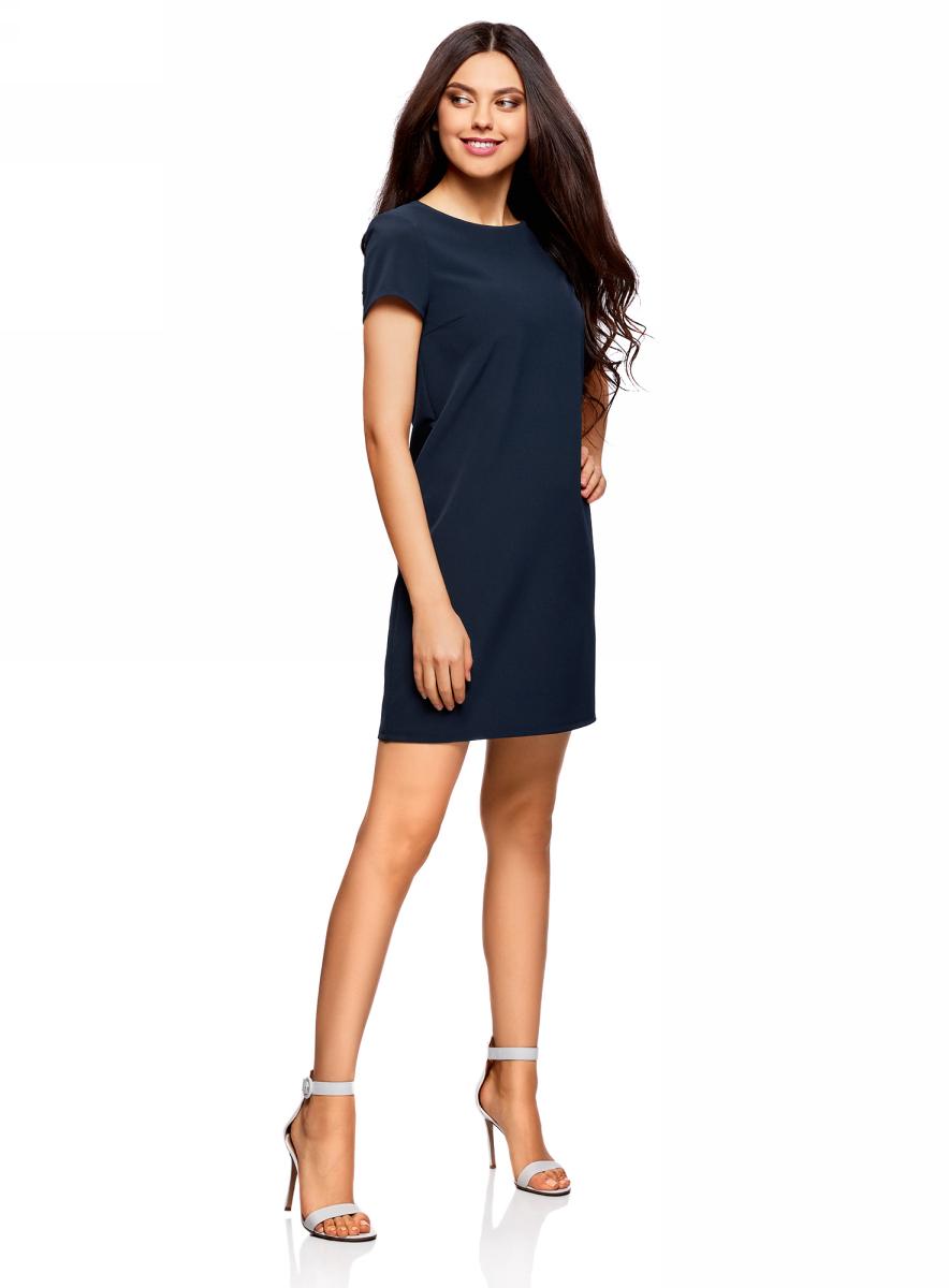 Платье oodji Collection, цвет: темно-синий. 22C01001B/42250/7900N. Размер 40 (46-170)22C01001B/42250/7900NСтильное платье oodji изготовлено из качественного смесового материала. Модель прямого кроя с круглой горловиной и короткими рукавами. Платье застегивается на пуговицу на спинке.