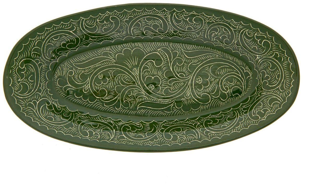 Селедочница Риштанская керамика, 24 х 12 см. 19234441690278АУзбекская посуда известна всему миру уже более тысячи лет. Ей любовались царские особы, на ней подавали еду шейхам и знатным персонам. Формула глазури передаётся из поколения в поколение. По сей день качественные изделия продолжают восхищать своей идеальной формой.Данный предмет подойдёт для повседневной и праздничной сервировки. Дополните стол текстилем и салфетками в тон, чтобы получить элегантное убранство с яркими акцентами.