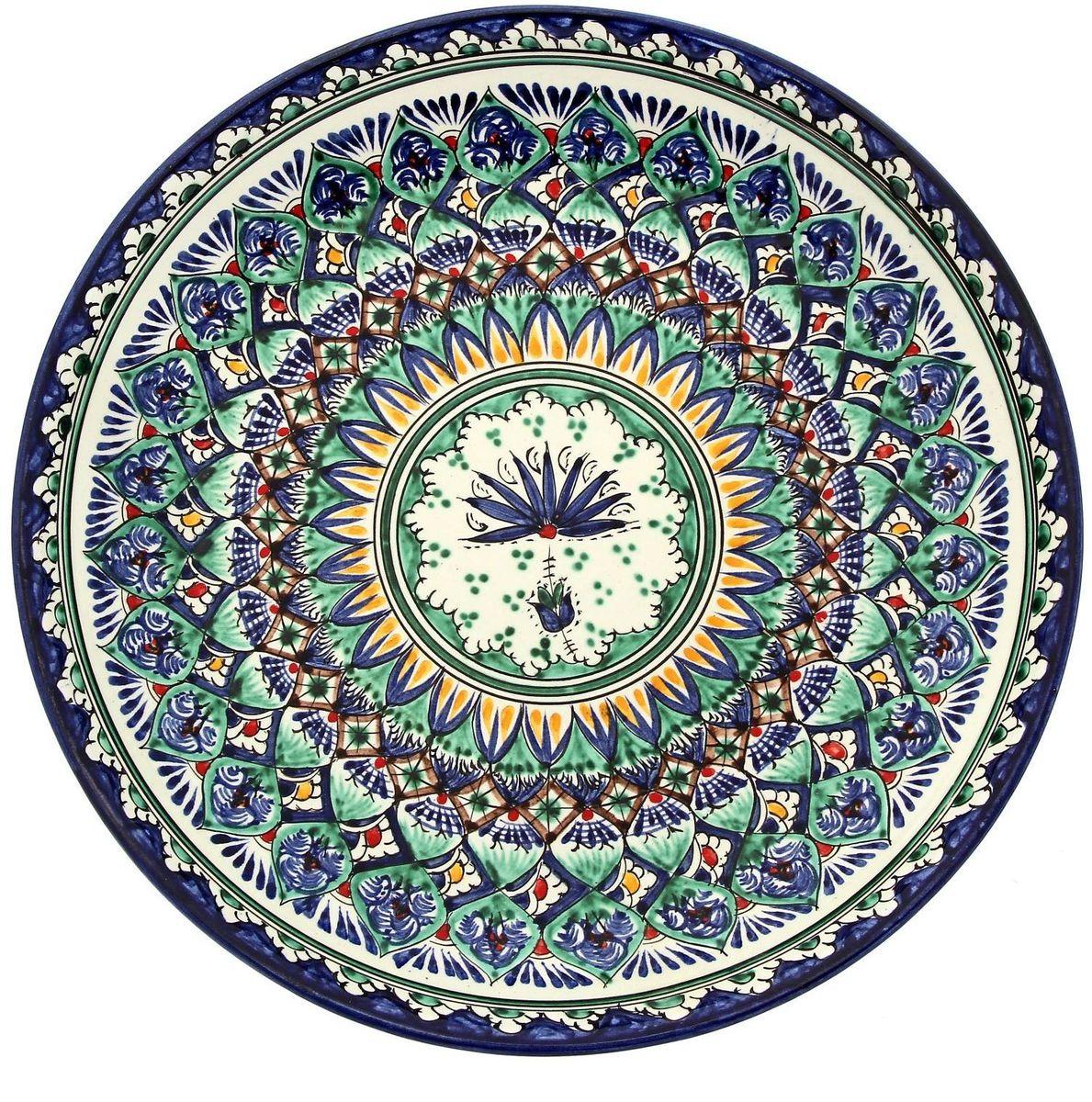 Ляган Риштанская керамика, диаметр 28 см. 19234591923459Ляган — это не просто обеденный атрибут, это украшение стола. Посуда с национальной росписью станет отменным подарком для ценителей высокородной посуды.Риштан — город на востоке Узбекистана, один из древнейших в Ферганской долине. С давних времён Риштан славится своим гончарным искусством изготовления цветной керамики. Красноватую глину для изделия добывают в самом городе. Мастера утверждают, что их глина настолько высокого качества, что даже не нуждается в предварительной обработке. Дополните коллекцию кухонных аксессуаров пряными восточными нотами.