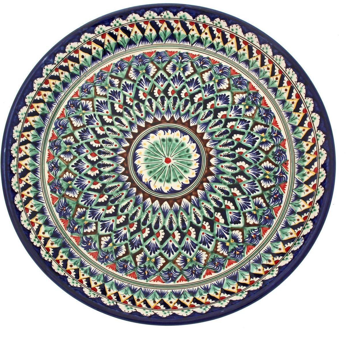 Ляган Риштанская керамика, диаметр 36 см. 19234711923471Ляган — это не просто обеденный атрибут, это украшение стола. Посуда с национальной росписью станет отменным подарком для ценителей высокородной посуды.Риштан — город на востоке Узбекистана, один из древнейших в Ферганской долине. С давних времён Риштан славится своим гончарным искусством изготовления цветной керамики. Красноватую глину для изделия добывают в самом городе. Мастера утверждают, что их глина настолько высокого качества, что даже не нуждается в предварительной обработке. Дополните коллекцию кухонных аксессуаров пряными восточными нотами.