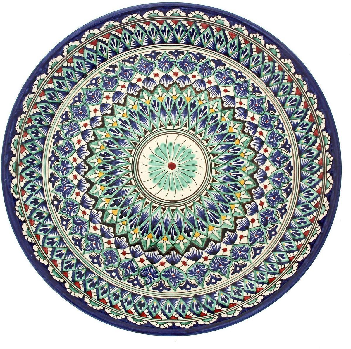 Ляган Риштанская керамика, диаметр 36 см. 19234721923472Ляган — это не просто обеденный атрибут, это украшение стола. Посуда с национальной росписью станет отменным подарком для ценителей высокородной посуды.Риштан — город на востоке Узбекистана, один из древнейших в Ферганской долине. С давних времён Риштан славится своим гончарным искусством изготовления цветной керамики. Красноватую глину для изделия добывают в самом городе. Мастера утверждают, что их глина настолько высокого качества, что даже не нуждается в предварительной обработке. Дополните коллекцию кухонных аксессуаров пряными восточными нотами.