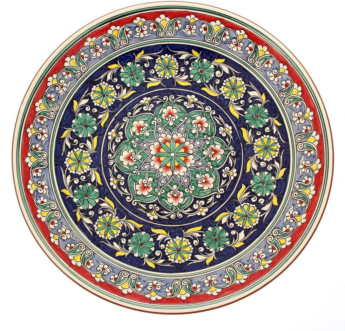 Ляган Риштанская керамика, диаметр 41 см. 19234811923481Ляган — это не просто обеденный атрибут, это украшение стола. Посуда с национальной росписью станет отменным подарком для ценителей высокородной посуды.Риштан — город на востоке Узбекистана, один из древнейших в Ферганской долине. С давних времён Риштан славится своим гончарным искусством изготовления цветной керамики. Красноватую глину для изделия добывают в самом городе. Мастера утверждают, что их глина настолько высокого качества, что даже не нуждается в предварительной обработке. Дополните коллекцию кухонных аксессуаров пряными восточными нотами.