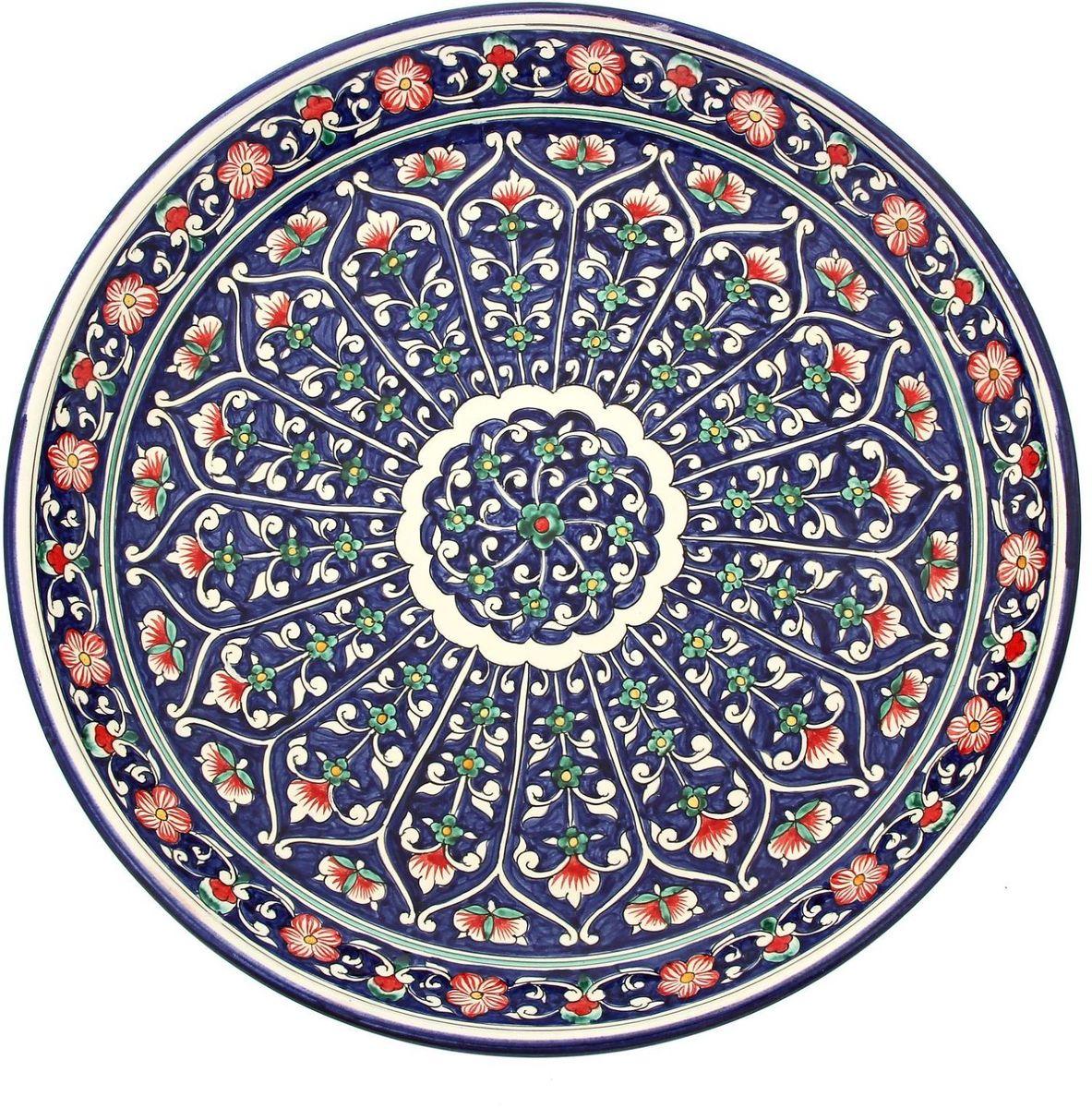 Ляган Риштанская керамика, диаметр 36 см. 19234871923487Ляган — это не просто обеденный атрибут, это украшение стола. Посуда с национальной росписью станет отменным подарком для ценителей высокородной посуды.Риштан — город на востоке Узбекистана, один из древнейших в Ферганской долине. С давних времён Риштан славится своим гончарным искусством изготовления цветной керамики. Красноватую глину для изделия добывают в самом городе. Мастера утверждают, что их глина настолько высокого качества, что даже не нуждается в предварительной обработке. Дополните коллекцию кухонных аксессуаров пряными восточными нотами.