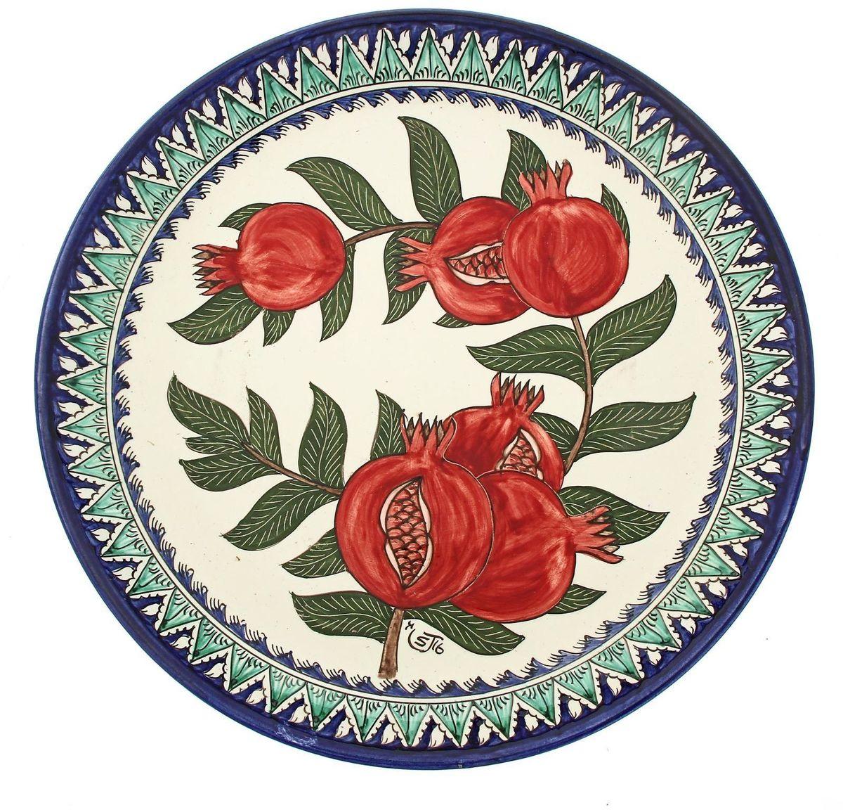 Ляган Риштанская керамика Гранаты, диаметр 36 см. 19242171924217Ляган — это не просто обеденный атрибут, это украшение стола. Посуда с национальной росписью станет отменным подарком для ценителей высокородной посуды.Риштан — город на востоке Узбекистана, один из древнейших в Ферганской долине. С давних времён Риштан славится своим гончарным искусством изготовления цветной керамики. Красноватую глину для изделия добывают в самом городе. Мастера утверждают, что их глина настолько высокого качества, что даже не нуждается в предварительной обработке. Дополните коллекцию кухонных аксессуаров пряными восточными нотами.