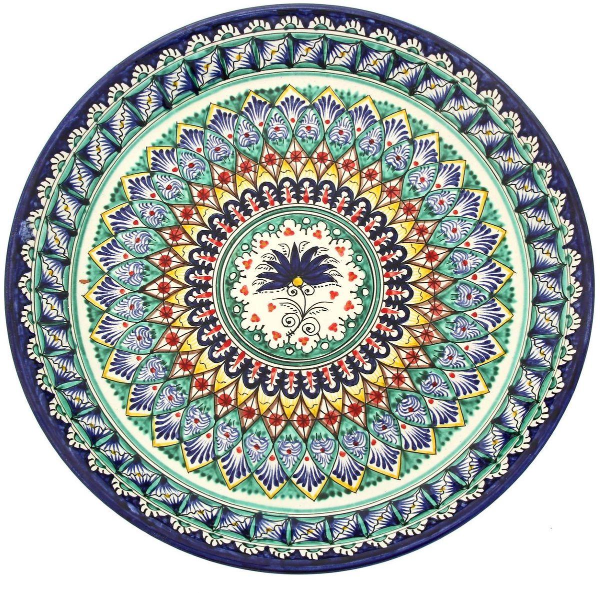 Ляган Риштанская керамика, диаметр 36 см. 19242251924225Ляган — это не просто обеденный атрибут, это украшение стола. Посуда с национальной росписью станет отменным подарком для ценителей высокородной посуды.Риштан — город на востоке Узбекистана, один из древнейших в Ферганской долине. С давних времён Риштан славится своим гончарным искусством изготовления цветной керамики. Красноватую глину для изделия добывают в самом городе. Мастера утверждают, что их глина настолько высокого качества, что даже не нуждается в предварительной обработке. Дополните коллекцию кухонных аксессуаров пряными восточными нотами.