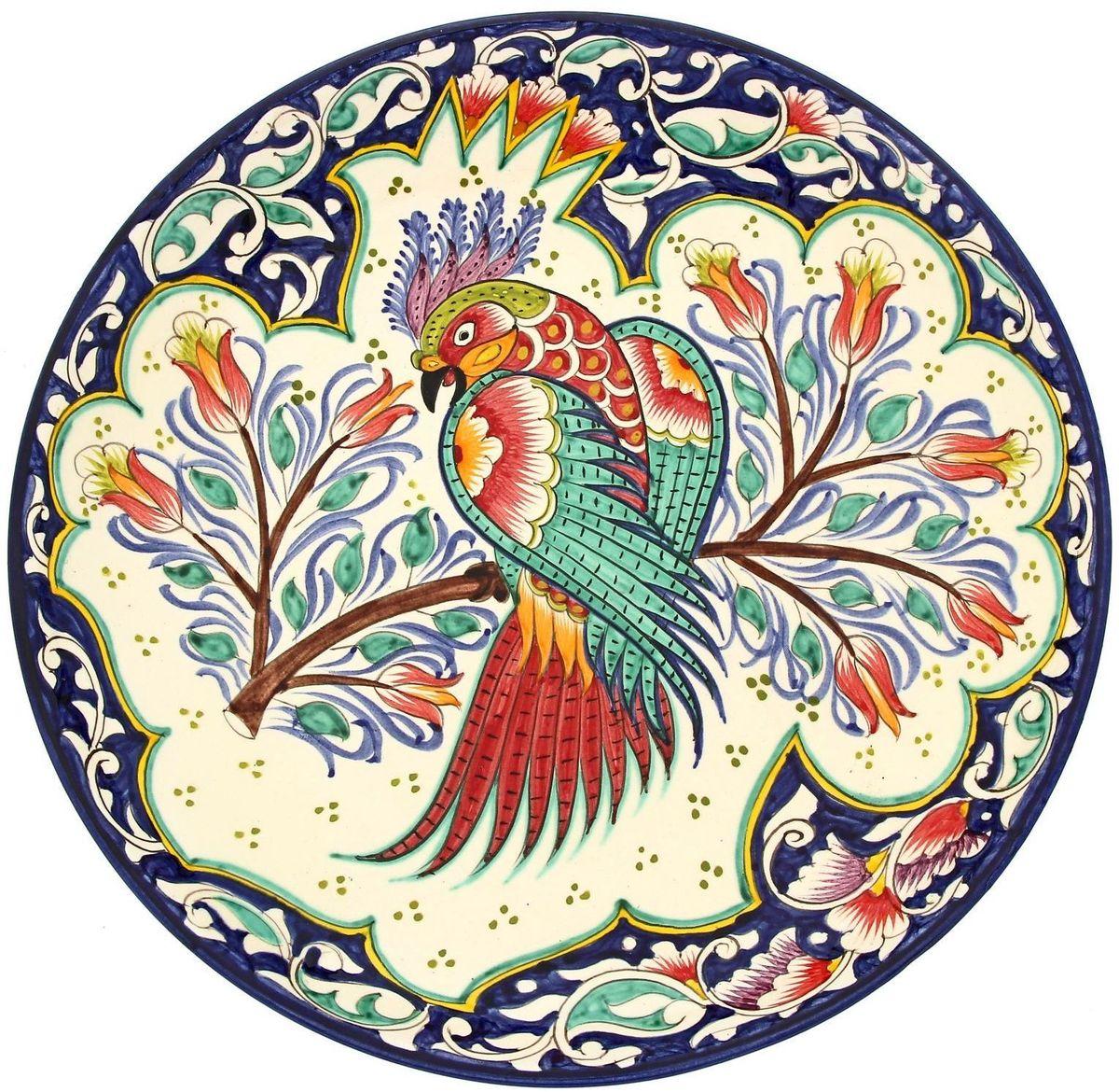 Ляган Риштанская керамика Жар-птица, диаметр 31 см1924233Ляган — это не просто обеденный атрибут, это украшение стола. Посуда с национальной росписью станет отменным подарком для ценителей высокородной посуды.Риштан — город на востоке Узбекистана, один из древнейших в Ферганской долине. С давних времён Риштан славится своим гончарным искусством изготовления цветной керамики. Красноватую глину для изделия добывают в самом городе. Мастера утверждают, что их глина настолько высокого качества, что даже не нуждается в предварительной обработке. Дополните коллекцию кухонных аксессуаров пряными восточными нотами.