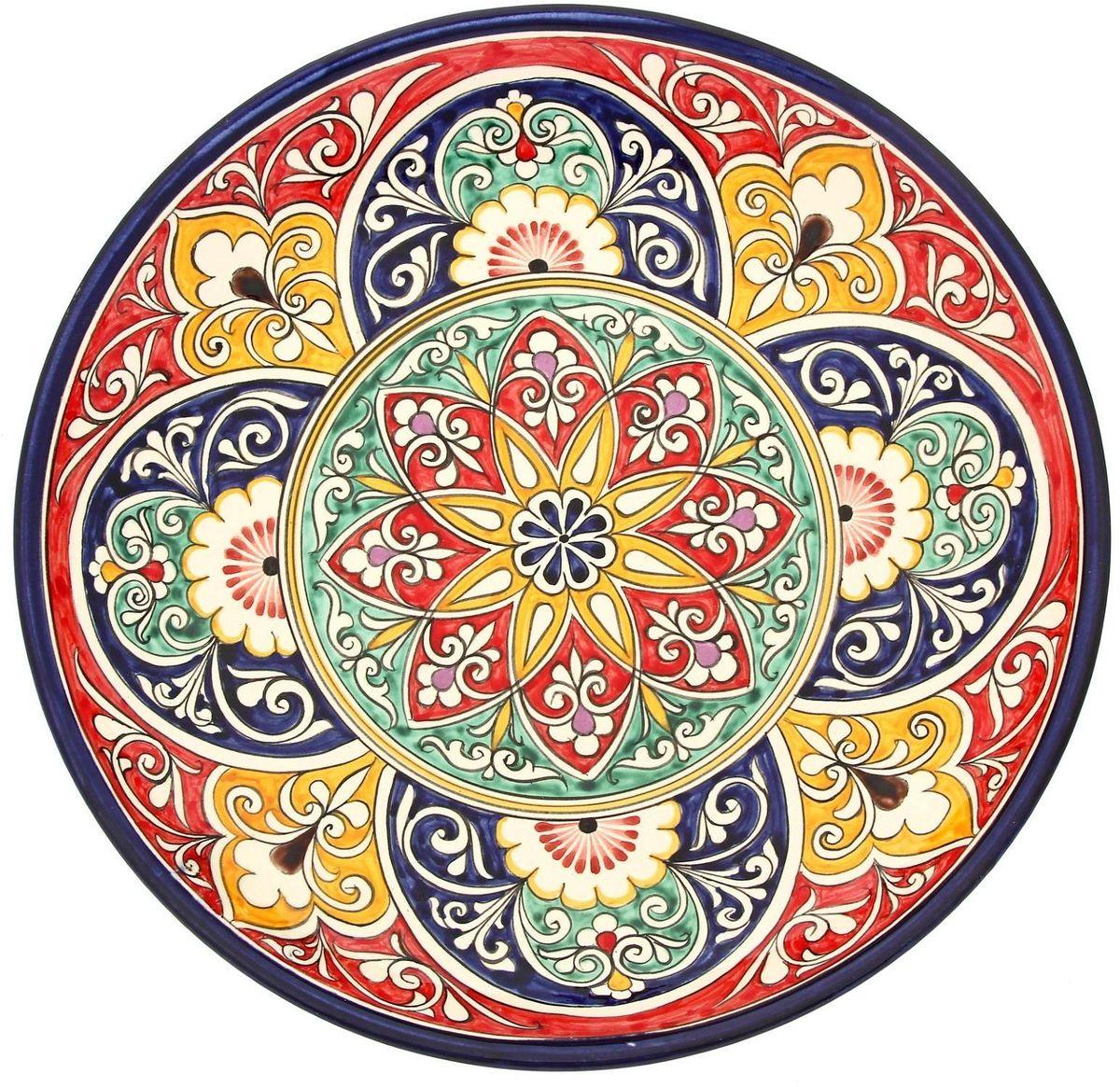 """Ляган """"Риштанская керамика"""" — это не просто обеденный атрибут, это украшение стола. Посуда с национальной росписью станет отменным подарком для ценителей высокородной посуды. Риштан — город на востоке Узбекистана, один из древнейших в Ферганской долине. С давних времен Риштан славится своим гончарным искусством изготовления цветной керамики. Красноватую глину для изделия добывают в самом городе. Мастера утверждают, что их глина настолько высокого качества, что даже не нуждается в предварительной обработке. Дополните коллекцию кухонных аксессуаров пряными восточными нотами."""