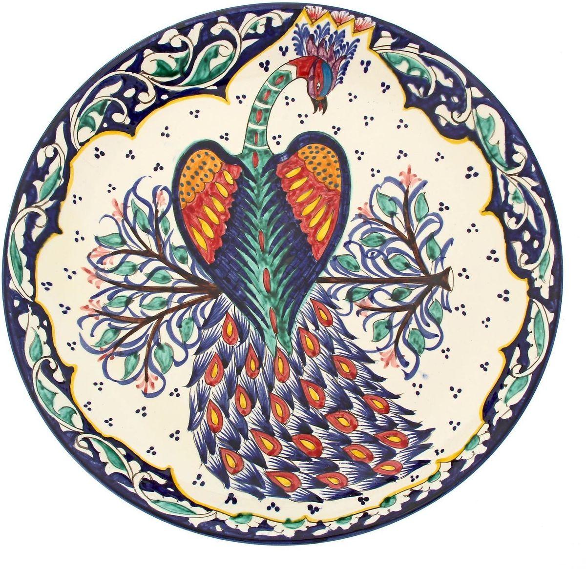 """Ляган Риштанская керамика """"Павлин"""" — это не просто обеденный атрибут, это украшение стола. Посуда с национальной росписью станет отменным подарком для ценителей высокородной посуды. Риштан — город на востоке Узбекистана, один из древнейших в Ферганской долине. С давних времен Риштан славится своим гончарным искусством изготовления цветной керамики. Красноватую глину для изделия добывают в самом городе. Мастера утверждают, что их глина настолько высокого качества, что даже не нуждается в предварительной обработке. Дополните коллекцию кухонных аксессуаров пряными восточными нотами."""