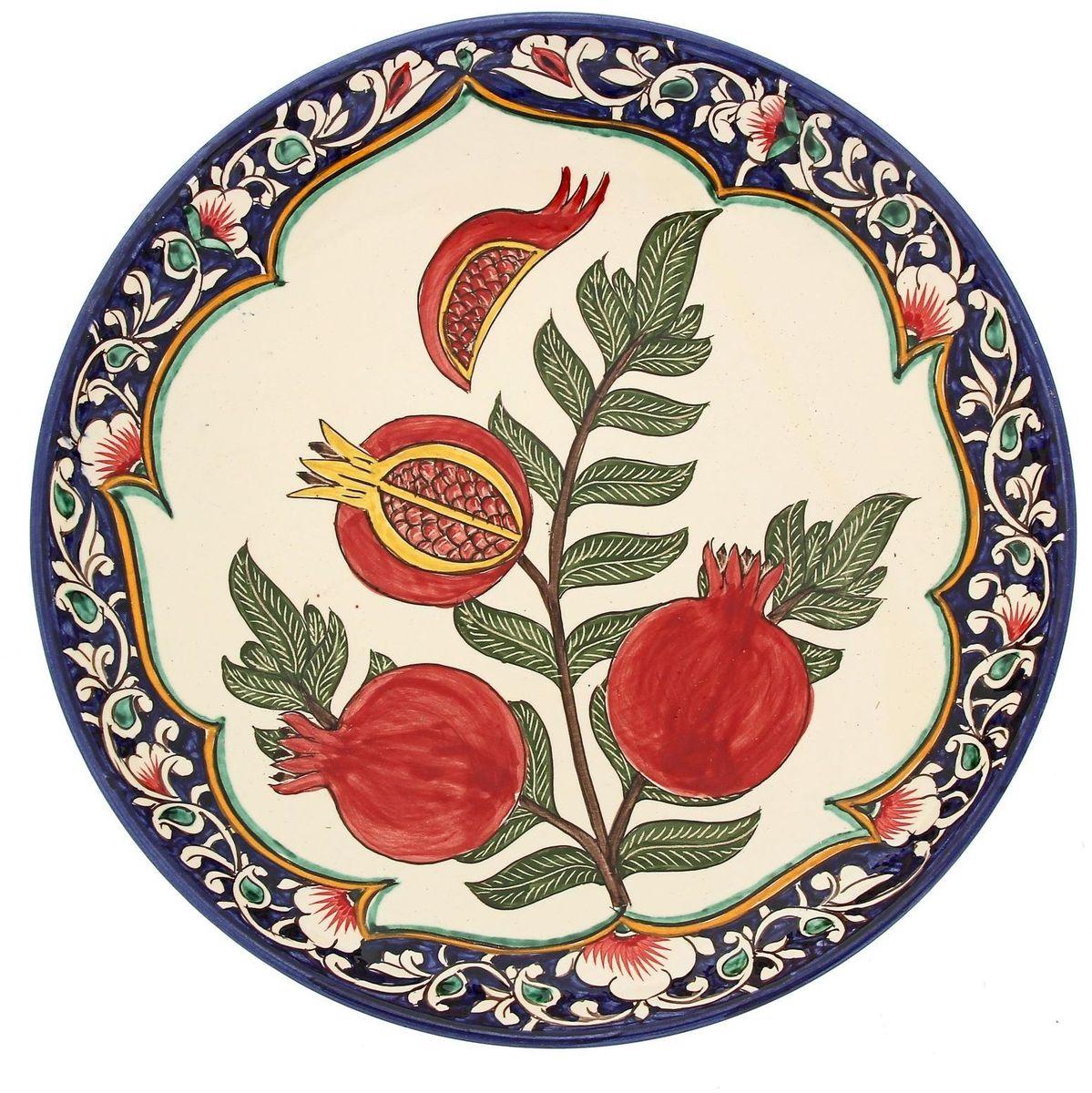 Ляган Риштанская керамика Гранаты, диаметр 31 см1924241Ляган — это не просто обеденный атрибут, это украшение стола. Посуда с национальной росписью станет отменным подарком для ценителей высокородной посуды.Риштан — город на востоке Узбекистана, один из древнейших в Ферганской долине. С давних времён Риштан славится своим гончарным искусством изготовления цветной керамики. Красноватую глину для изделия добывают в самом городе. Мастера утверждают, что их глина настолько высокого качества, что даже не нуждается в предварительной обработке. Дополните коллекцию кухонных аксессуаров пряными восточными нотами.