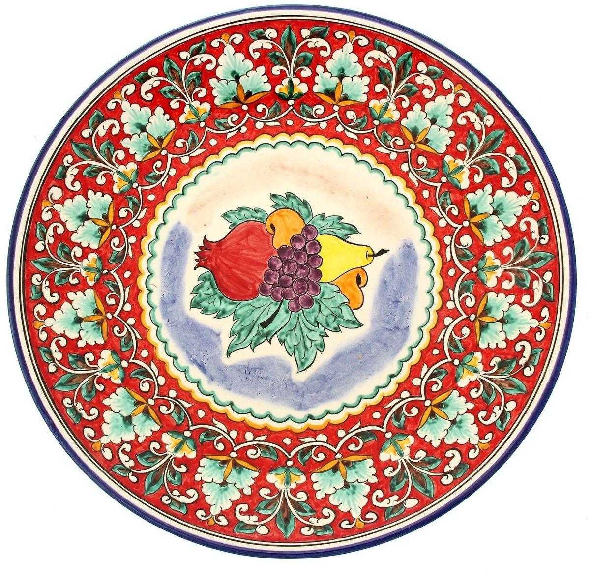 Ляган Риштанская керамика Фрукты, диаметр 41 см1924245Ляган Риштанская керамика - это не просто обеденный атрибут, это украшение стола. Посуда с национальной росписью станет отменным подарком для ценителей высокородной посуды.Риштан - город на востоке Узбекистана, один из древнейших в Ферганской долине. С давних времен Риштан славится своим гончарным искусством изготовления цветной керамики. Красноватую глину для изделия добывают в самом городе. Мастера утверждают, что их глина настолько высокого качества, что даже не нуждается в предварительной обработке. Дополните коллекцию кухонных аксессуаров пряными восточными нотами!