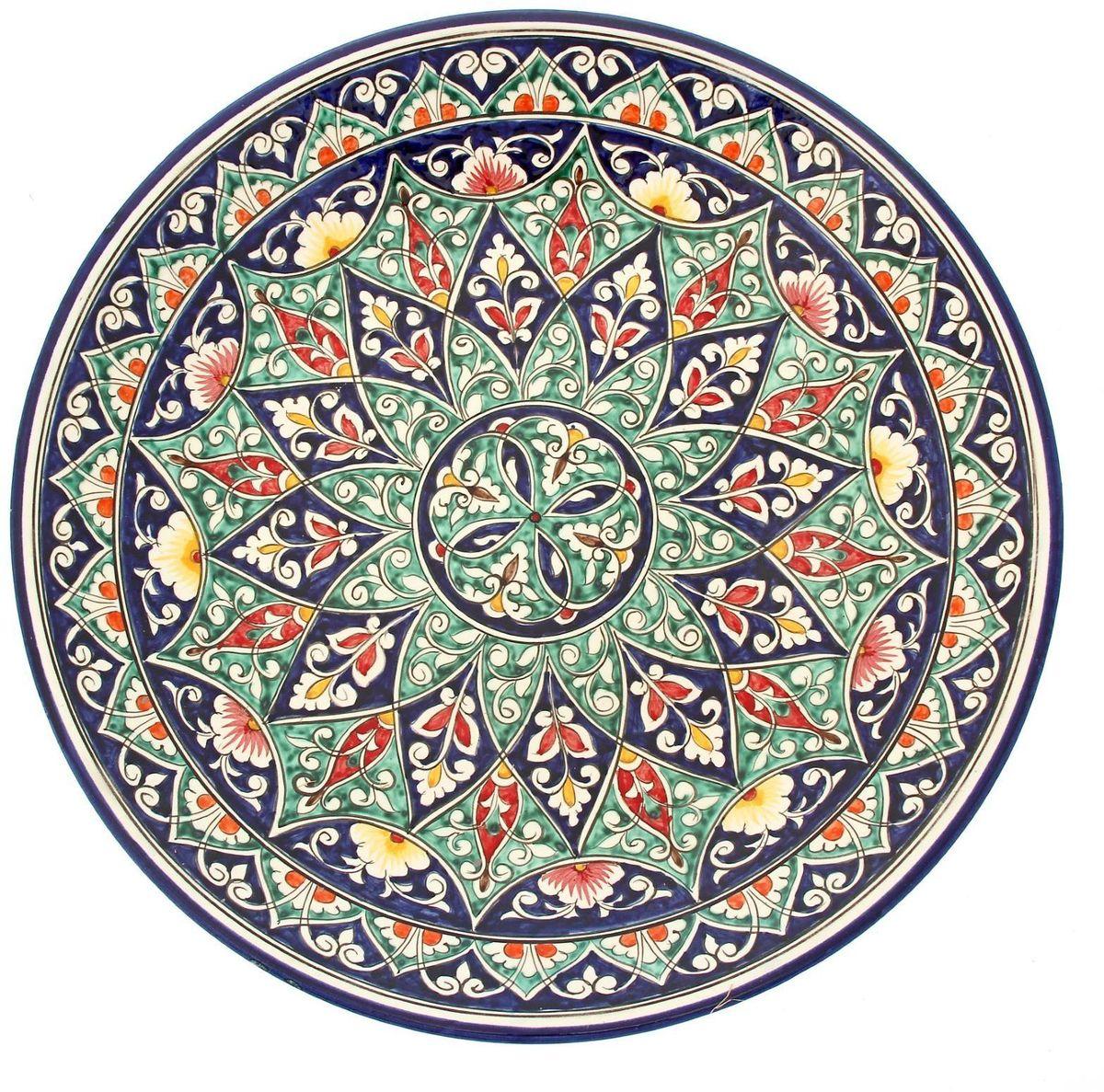 Ляган Риштанская керамика, диаметр 41 см. 19242462245470Ляган Риштанская керамика - это не просто обеденный атрибут, это украшение стола. Посуда с национальной росписью станет отменным подарком для ценителей высокородной посуды.Риштан - город на востоке Узбекистана, один из древнейших в Ферганской долине. С давних времен Риштан славится своим гончарным искусством изготовления цветной керамики. Красноватую глину для изделия добывают в самом городе. Мастера утверждают, что их глина настолько высокого качества, что даже не нуждается в предварительной обработке. Дополните коллекцию кухонных аксессуаров пряными восточными нотами!