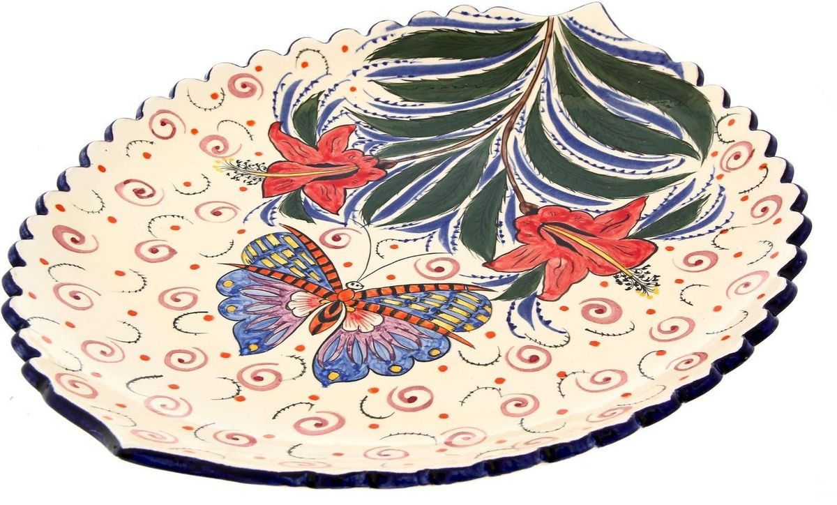 Ляган Риштанская керамика Бабочка, 41 х 34 см. 19242811924281Ляган — это не просто обеденный атрибут, это украшение стола. Посуда с национальной росписью станет отменным подарком для ценителей высокородной посуды.Риштан — город на востоке Узбекистана, один из древнейших в Ферганской долине. С давних времён Риштан славится своим гончарным искусством изготовления цветной керамики. Красноватую глину для изделия добывают в самом городе. Мастера утверждают, что их глина настолько высокого качества, что даже не нуждается в предварительной обработке. Дополните коллекцию кухонных аксессуаров пряными восточными нотами.