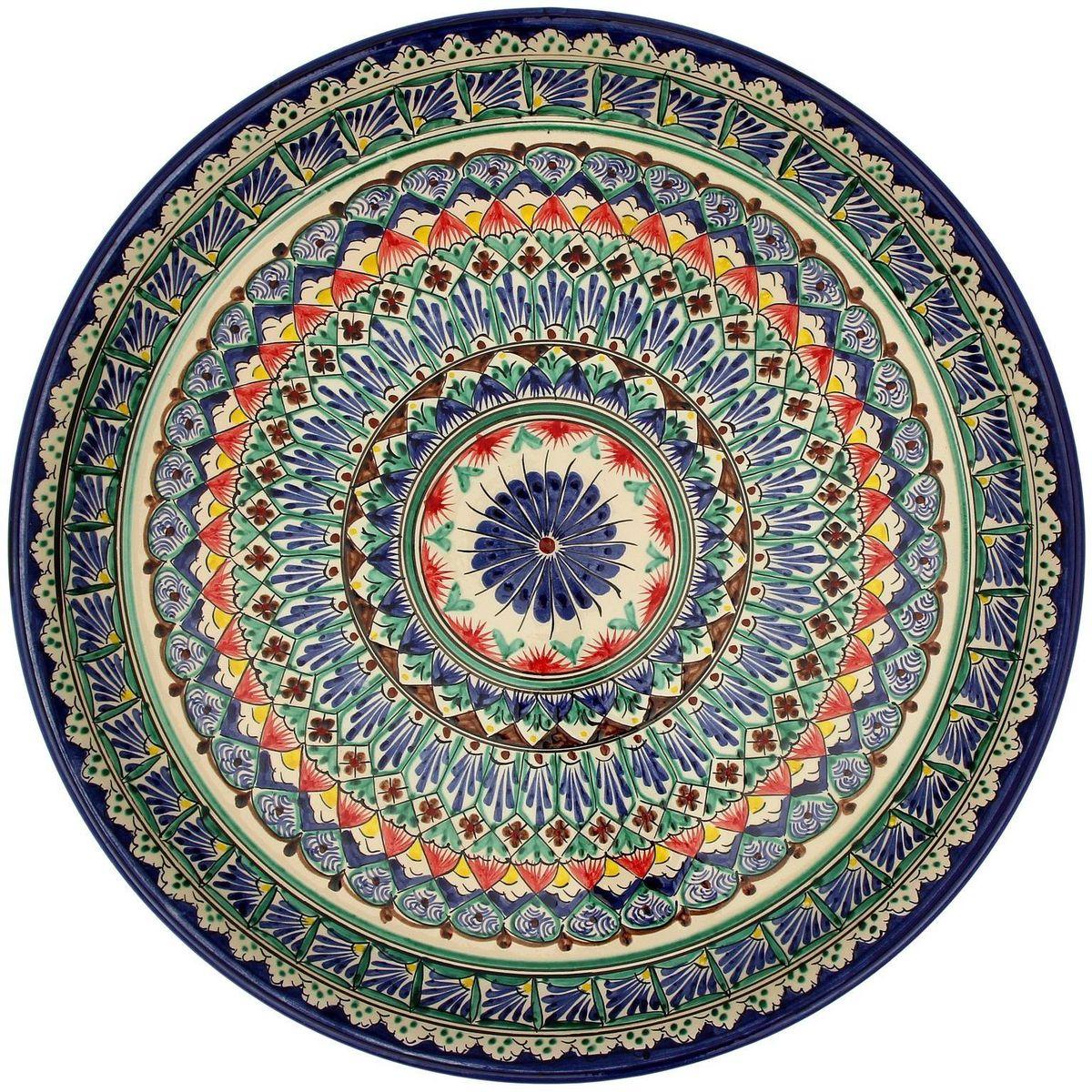 Ляган Риштанская керамика, диаметр, 45 см. 21386962138696Ляган — это не просто обеденный атрибут, это украшение стола. Посуда с национальной росписью станет отменным подарком для ценителей высокородной посуды.Риштан — город на востоке Узбекистана, один из древнейших в Ферганской долине. С давних времён Риштан славится своим гончарным искусством изготовления цветной керамики. Красноватую глину для изделия добывают в самом городе. Мастера утверждают, что их глина настолько высокого качества, что даже не нуждается в предварительной обработке. Дополните коллекцию кухонных аксессуаров пряными восточными нотами.