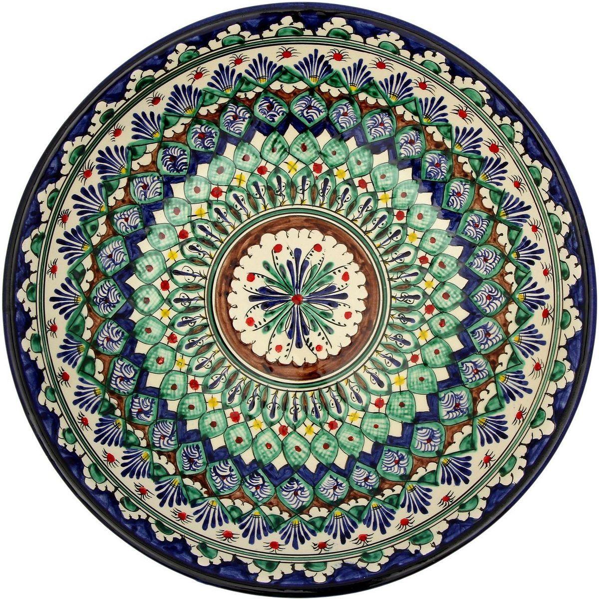 Ляган Риштанская керамика, диаметр, 33 см. 21386992138699Ляган — это не просто обеденный атрибут, это украшение стола. Посуда с национальной росписью станет отменным подарком для ценителей высокородной посуды.Риштан — город на востоке Узбекистана, один из древнейших в Ферганской долине. С давних времён Риштан славится своим гончарным искусством изготовления цветной керамики. Красноватую глину для изделия добывают в самом городе. Мастера утверждают, что их глина настолько высокого качества, что даже не нуждается в предварительной обработке. Дополните коллекцию кухонных аксессуаров пряными восточными нотами.