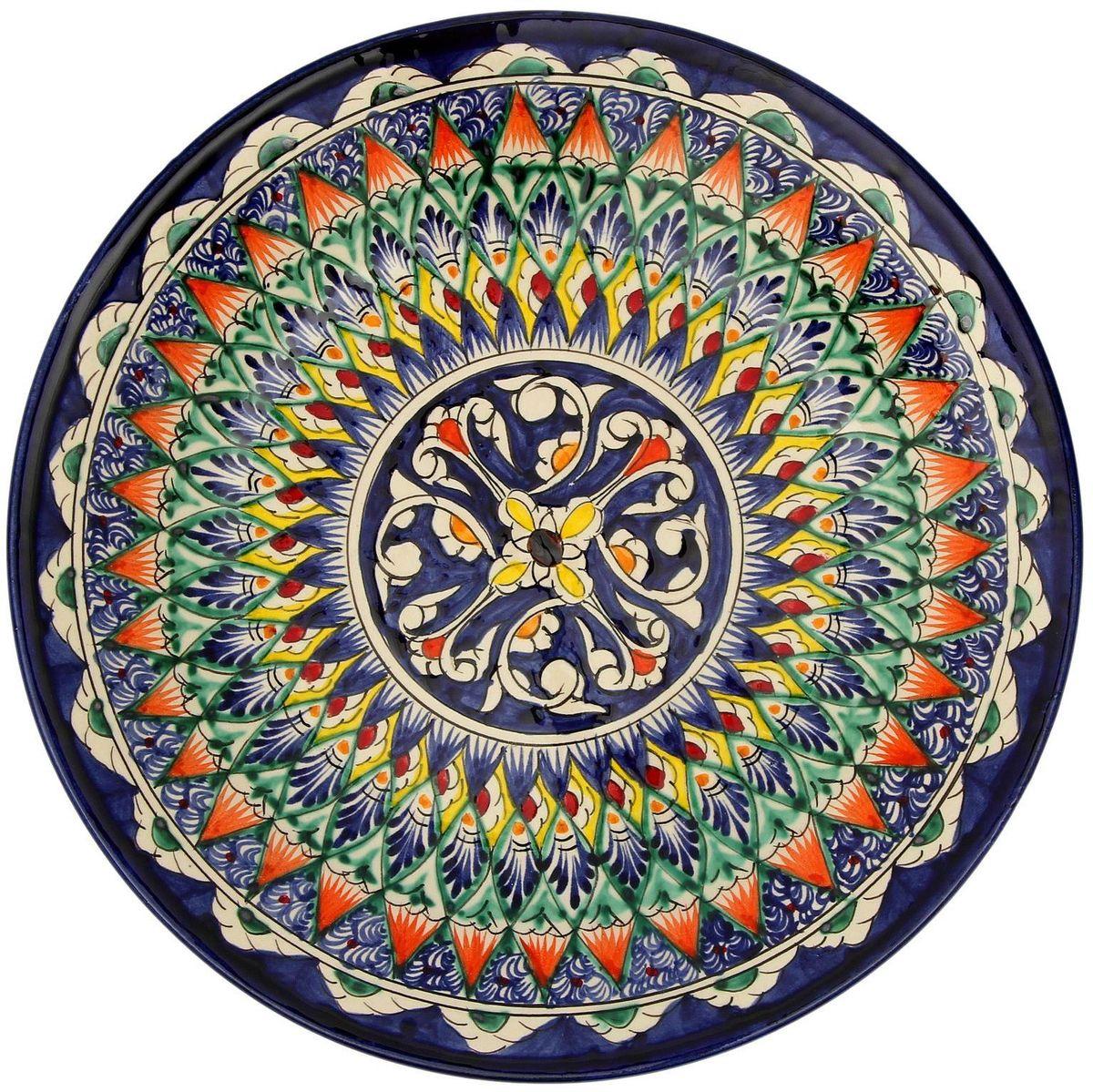 Тарелка Риштанская керамика, диаметр 27 см. 21387032138703Узбекская посуда известна всему миру уже более тысячи лет. Ей любовались царские особы, на ней подавали еду шейхам и знатным персонам. Формула глазури передаётся из поколения в поколение. По сей день качественные изделия продолжают восхищать своей идеальной формой.Данный предмет подойдёт для повседневной и праздничной сервировки. Дополните стол текстилем и салфетками в тон, чтобы получить элегантное убранство с яркими акцентами.Возможны отличия некоторых элементов рисунка от того, что представлено на фото. Товар расписывается вручную.