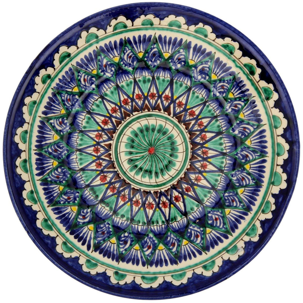 Тарелка Риштанская керамика, диаметр 23 см. 21387052138705Узбекская посуда известна всему миру уже более тысячи лет. Ей любовались царские особы, на ней подавали еду шейхам и знатным персонам. Тарелка с национальной росписью станет отменным подарком для ценителей высокородной посуды. Формула глазури передаётся из поколения в поколение. По сей день качественные изделия продолжают восхищать своей идеальной формой. Данный предмет подойдёт для повседневной и праздничной сервировки. Дополните стол текстилем и салфетками в тон, чтобы получить элегантное убранство с яркими акцентами.Возможны отличия некоторых элементов рисунка от того, что представлено на фото. Товар расписывается вручную.