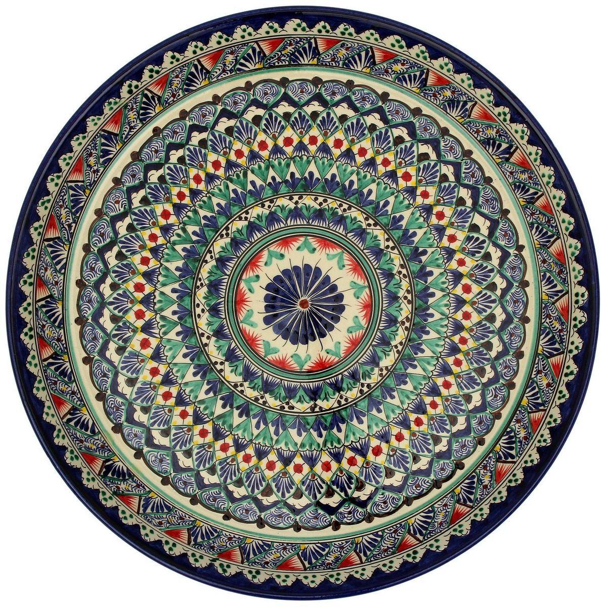 Ляган Риштанская керамика, диаметр, 45 см. 21530012153001Ляган — это не просто обеденный атрибут, это украшение стола. Посуда с национальной росписью станет отменным подарком для ценителей высокородной посуды.Риштан — город на востоке Узбекистана, один из древнейших в Ферганской долине. С давних времён Риштан славится своим гончарным искусством изготовления цветной керамики. Красноватую глину для изделия добывают в самом городе. Мастера утверждают, что их глина настолько высокого качества, что даже не нуждается в предварительной обработке. Дополните коллекцию кухонных аксессуаров пряными восточными нотами.