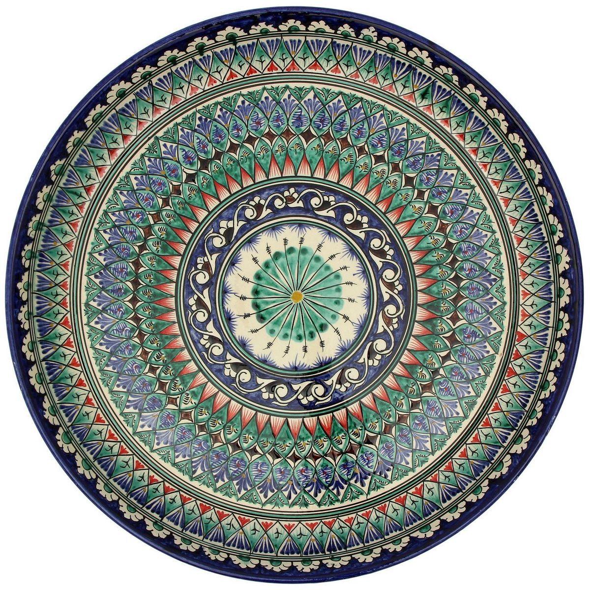 Ляган Риштанская керамика, диаметр, 45 см. 21550002155000Ляган — это не просто обеденный атрибут, это украшение стола. Посуда с национальной росписью станет отменным подарком для ценителей высокородной посуды.Риштан — город на востоке Узбекистана, один из древнейших в Ферганской долине. С давних времён Риштан славится своим гончарным искусством изготовления цветной керамики. Красноватую глину для изделия добывают в самом городе. Мастера утверждают, что их глина настолько высокого качества, что даже не нуждается в предварительной обработке. Дополните коллекцию кухонных аксессуаров пряными восточными нотами.