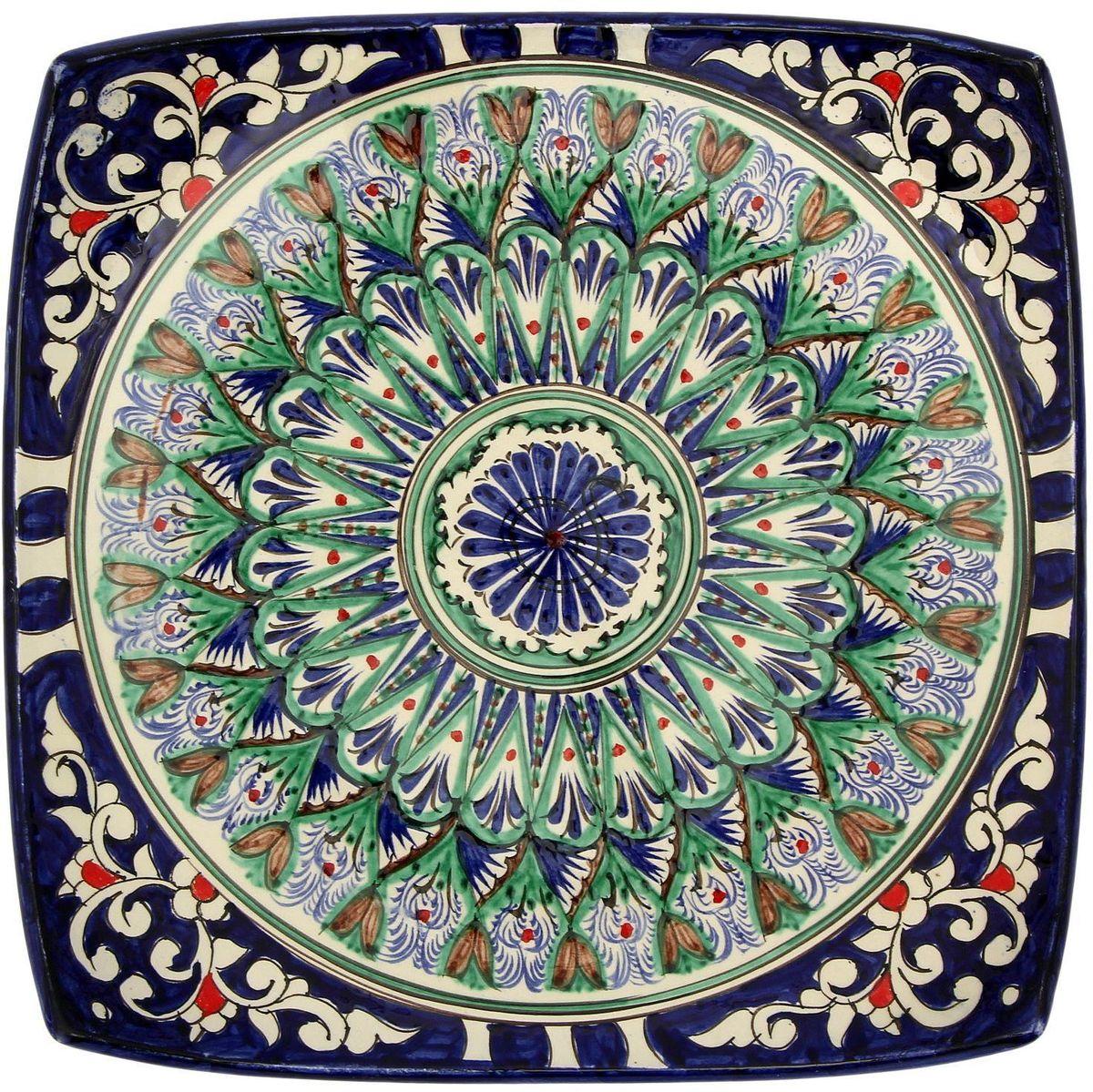 Ляган Риштанская керамика, 31 х 31 см. 21580002158000Ляган — это не просто обеденный атрибут, это украшение стола. Посуда с национальной росписью станет отменным подарком для ценителей высокородной посуды.Риштан — город на востоке Узбекистана, один из древнейших в Ферганской долине. С давних времён Риштан славится своим гончарным искусством изготовления цветной керамики. Красноватую глину для изделия добывают в самом городе. Мастера утверждают, что их глина настолько высокого качества, что даже не нуждается в предварительной обработке. Дополните коллекцию кухонных аксессуаров пряными восточными нотами.