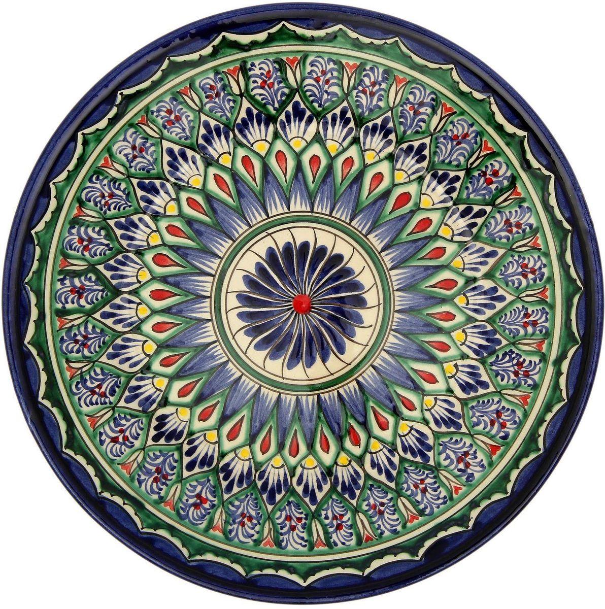 Тарелка Риштанская керамика, диаметр 23 см. 21580062158006Узбекская посуда известна всему миру уже более тысячи лет. Ей любовались царские особы, на ней подавали еду шейхам и знатным персонам. Формула глазури передаётся из поколения в поколение. По сей день качественные изделия продолжают восхищать своей идеальной формой.Данный предмет подойдёт для повседневной и праздничной сервировки. Дополните стол текстилем и салфетками в тон, чтобы получить элегантное убранство с яркими акцентами.Возможны отличия некоторых элементов рисунка от того, что представлено на фото. Товар расписывается вручную.