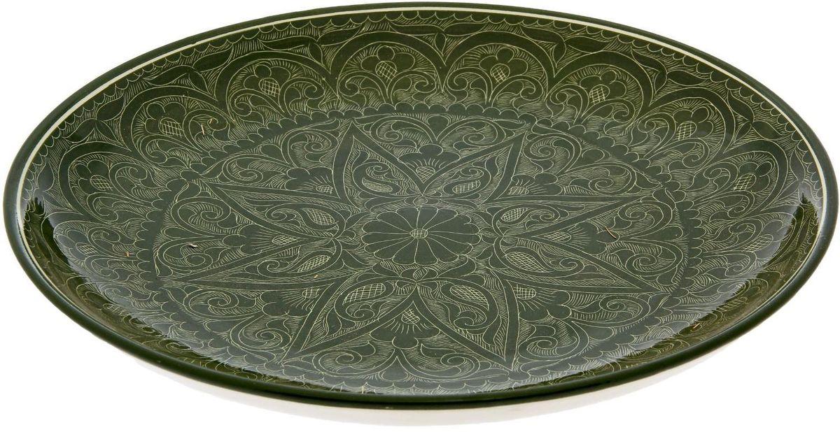 """Ляган """"Риштанская керамика"""" — это не просто обеденный атрибут, это украшение стола. Посуда с национальной росписью станет отменным подарком для ценителей высокородной посуды. Риштан — город на востоке Узбекистана, один из древнейших в Ферганской долине. С давних времен Риштан славится своим гончарным искусством изготовления цветной керамики. Красноватую глину для изделия добывают в самом городе. Мастера утверждают, что их глина настолько высокого качества, что даже не нуждается в предварительной обработке. Дополните коллекцию кухонных аксессуаров пряными восточными нотами. Диаметр: 31 см."""