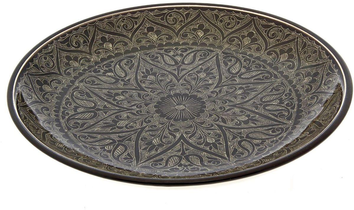 Ляган Риштанская керамика, диаметр 31 см. 22454722245472Ляган — это не просто обеденный атрибут, это украшение стола. Посуда с национальной росписью станет отменным подарком для ценителей высокородной посуды.Риштан — город на востоке Узбекистана, один из древнейших в Ферганской долине. С давних времён Риштан славится своим гончарным искусством изготовления цветной керамики. Красноватую глину для изделия добывают в самом городе. Мастера утверждают, что их глина настолько высокого качества, что даже не нуждается в предварительной обработке. Дополните коллекцию кухонных аксессуаров пряными восточными нотами.
