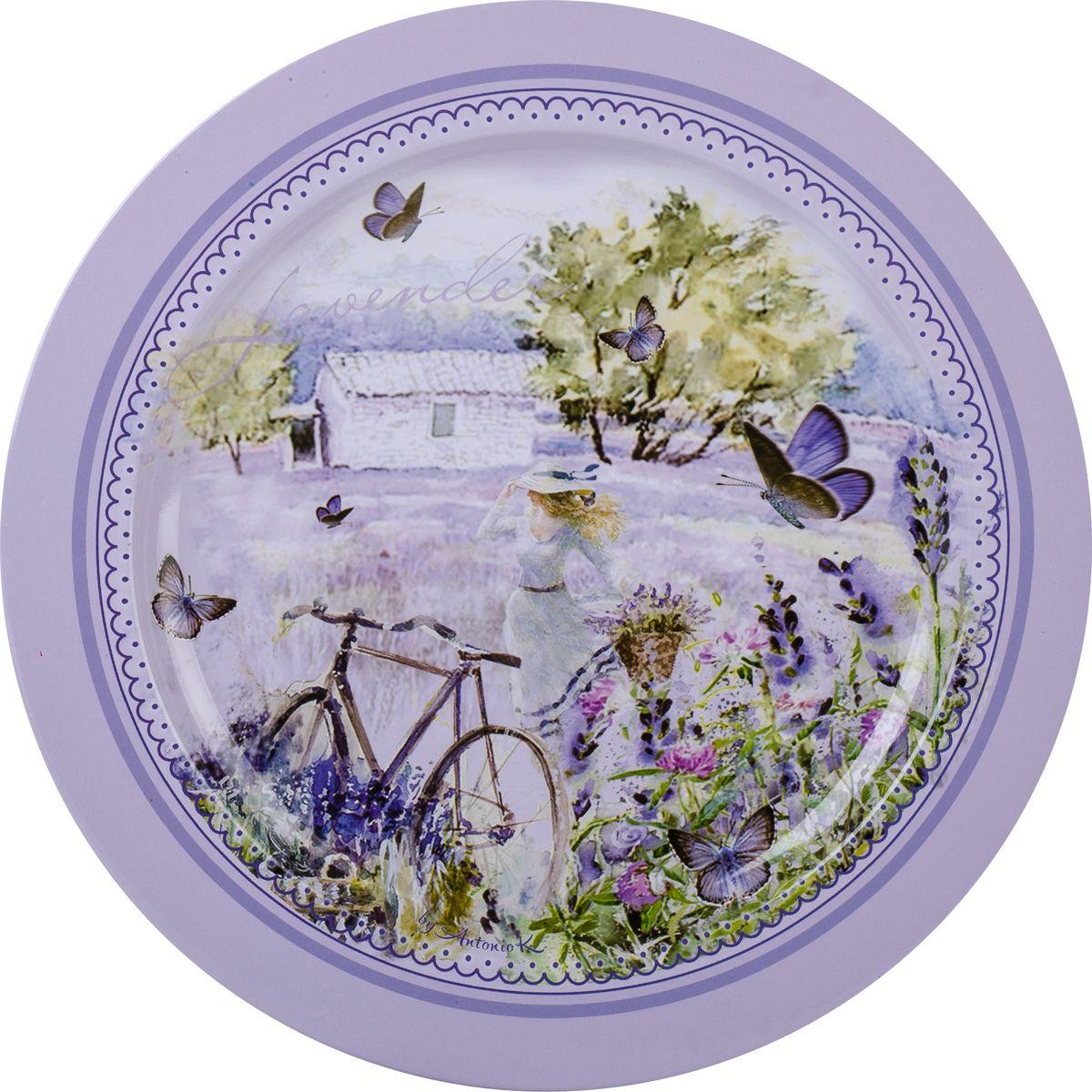 Поднос GiftnHome Лаванда, диаметр 25 смRT-25 LavenderПоднос GiftnHome Лаванда выполнен из жести. Поднос украсит любой интерьер и прекрасно подойдет для сервировки праздничного стола.Диаметр: 25 см.
