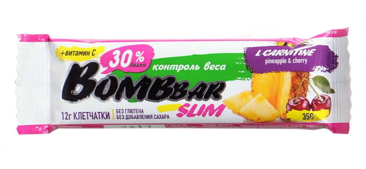 Батончик протеиновый BOMBBAR Slim, L-carnitine, ананас и вишня, 35 г14630019671323Батончик протеиновый Bombbar Slim - натуральный продукт, поможет снизить вес, питает мышечную массу, придает эффект сытости, улучшает общее состояние системы пищеварения, способствует росту полезной микрофлоры, способствует подержанию здорового уровня сахара в крови. Не содержит сахар. Не содержит ГМО. Как повысить эффективность тренировок с помощью спортивного питания? Статья OZON Гид