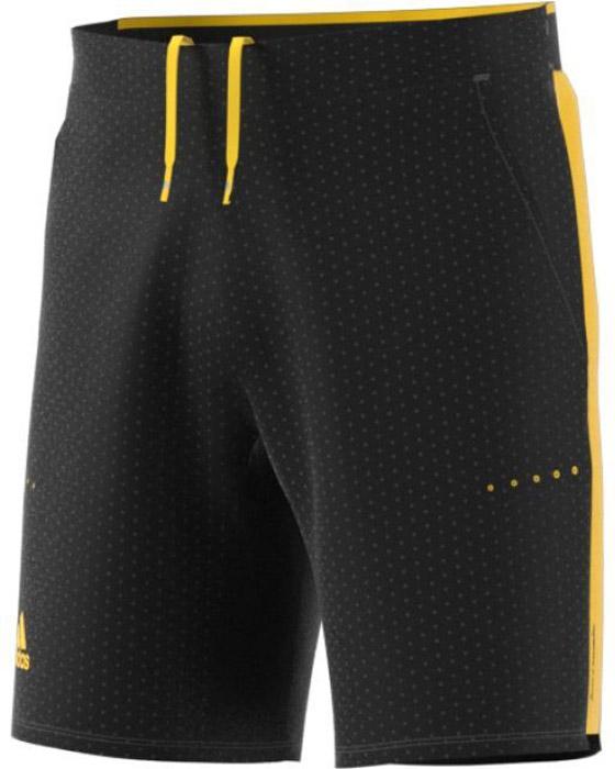 Шорты для тенниса мужские Adidas Bar. Wv Short, цвет: черный, желтый. BQ4905. Размер L (52/54)BQ4905Мужские теннисные шорты Adidas Bar. Wv Short прекрасно подойдут для жаркой погоды. Они изготовлены из полиэстера с добавлением эластана. Сетчатые вставки обеспечивают дополнительную вентиляцию. Эластичная ткань с контрастными, обработанными лазером отверстиями по бокам создает яркий и стильный образ. Технология climacool сохраняет приятные ощущения прохлады и свежести. Модель дополнена на поясе эластичной резинкойсо скрытым шнурком.