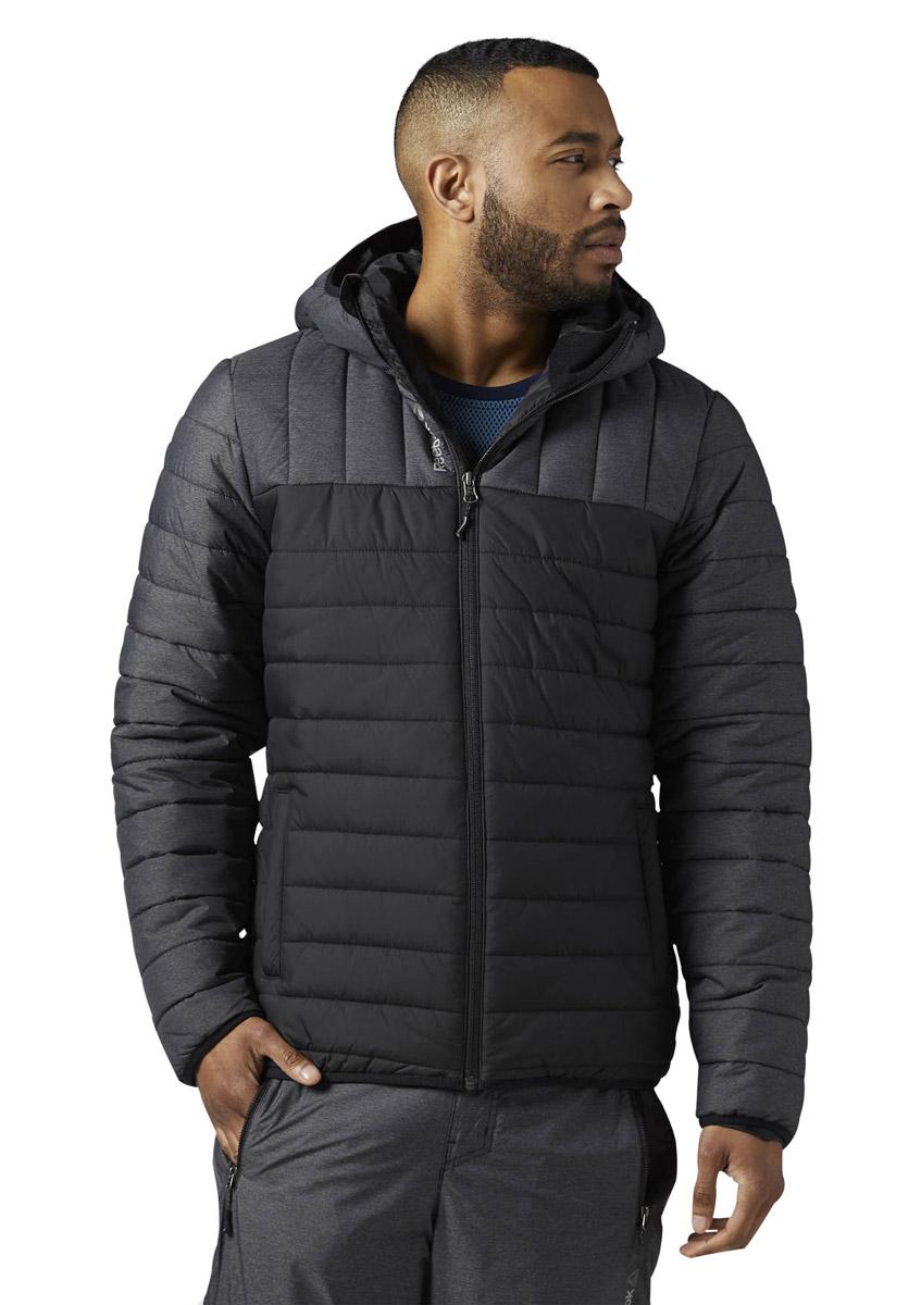 Куртка мужская Reebok Od Pad Jckt, цвет: черный. BR0462. Размер L (52/54)BR0462Мужская стеганая куртка Reebok выполнена из полиэстера. В качестве подкладки и утеплителя используется полиэстер. Модель с несъемным капюшоном застегивается на застежку-молнию. Рукава имеют эластичные манжеты. Спереди расположено два прорезных кармана. Куртка дополнена светоотражающими элементами.