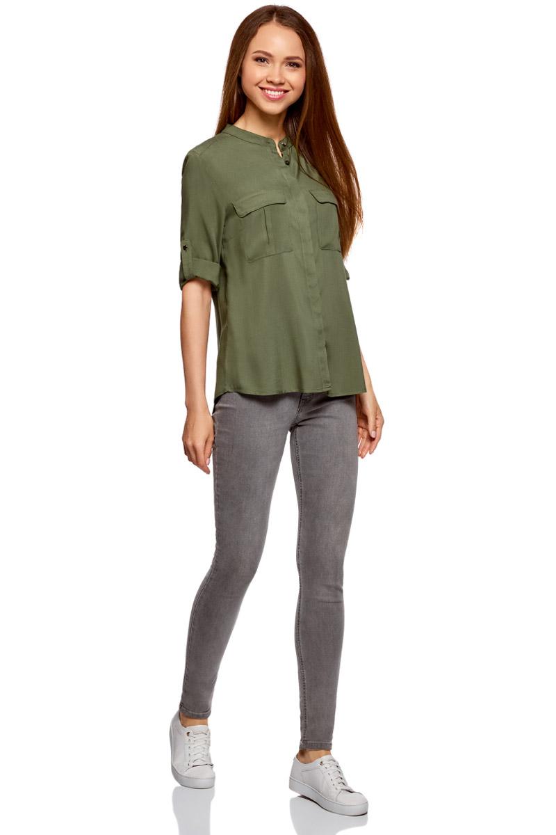 Блузка женская oodji Ultra, цвет: темно-зеленый. 11403225-2B/26346/6900N. Размер 34-170 (40-170)11403225-2B/26346/6900NМодная женская блузка oodji изготовлена из качественной вискозы и застегивается на пуговицы. Модель выполнена с рукавами 3/4, дополненными специальной шлевкой для подгиба. Передняя часть оформлена накладными карманами под клапанами.