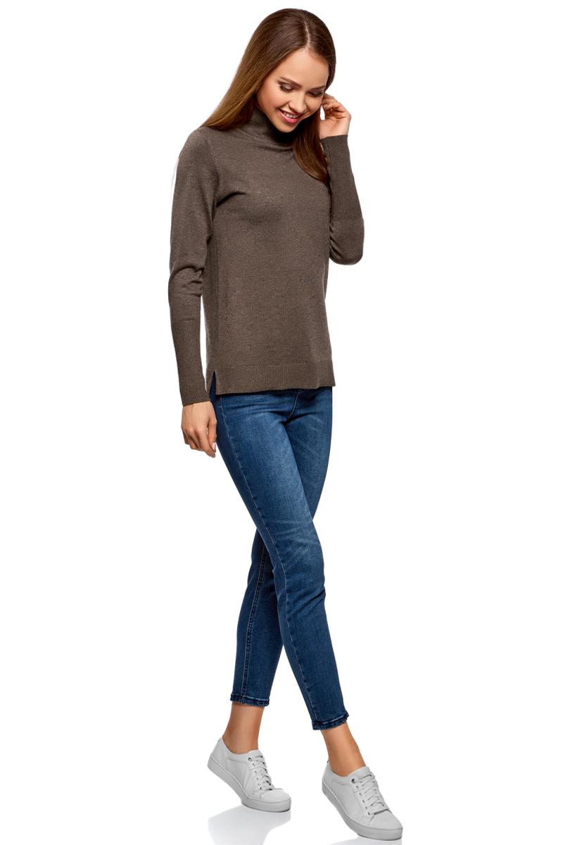 Свитер женский oodji Ultra, цвет: темно-коричневый меланж. 64412192B/47261/3900M. Размер XXL (52)64412192B/47261/3900MСвитер oodji с высоким воротником изготовлен из качественного смесового материала. Низ изделия и рукава дополнены вязаными резинками. По бокам имеются небольшие разрезы.