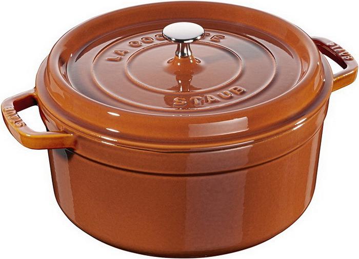 Кокот Staub, круглый, цвет: коричневый, 2,2 л11020806Изготовлена из чугуна, покрытого эмалью снаружи и внутри. Подходит для использования на всех типах плит и в духовке. Перед первым использованием снять этикетки, тщательно вымыть горячей водой с мыльным средством и высушить, затем нанести немного растительного масла на внутреннюю поверхность посуды, излишки масла удалить салфеткой. Мыть жидким моющим средством, без применения абразивных веществ и металлических губок. Пригодна для мытья в посудомоечной машине. При падении на твердую поверхность посуда может треснуть или разбиться. Металлические кухонные принадлежности могут повредить посуду. Избегать резкого нагревания и охлаждения, резкий перепад температуры может привести к повреждению посуды. Чтобы не обжечься, пользуйтесь прихватками.Адрес изготовителя:Zwilling Staub France S.A.S, 47 bis, rue des Vinaigriers, 75010 Paris, FRANCE (Цвиллинг Стауб Франс С.А.С 47 бис, ру де Винаигриерс, 75010 Париж, Франция) Уважаемые клиенты! Для сохранения свойств посуды из чугуна и предотвращения появления ржавчины чугунную посуду мойте только вручную, горячей или теплой водой, мягкой губкой или щёткой (не металлической) и обязательно вытирайте насухо. Для хранения смазывайте внутреннюю поверхность посуды растительным маслом, а перед следующим применением хорошо накалите посуду.
