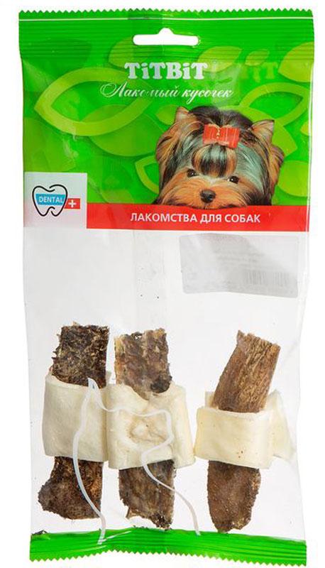 Лакомство Titbit Бантики с желудком, для собак005002Лакомство Titbit - высушенная говяжья кожа, обернутая вокруг пластины сушеного говяжьего желудка. Изделие содержит низкокалорийный, легкоусвояемый белок. Рубец говяжий представляет собой часть желудка КРС, точнее - первый из его преджелудков, в котором содержится полезная микрофлора. Ворсинки неочищенного сушеного рубца сохраняют на себе ферменты и витамины группы В, вырабатываемые его микрофлорой при жизни животного. Благодаря особой технологии сушки сохраняется до 60% процентов полезных веществ.