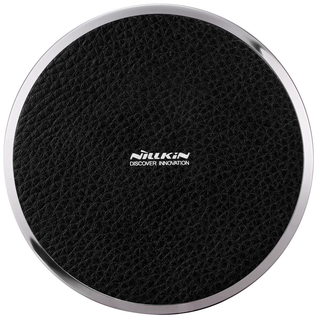 Nillkin Magic Disk III Wireless Charger, Black беспроводное зарядное устройство2000000108445Magic Disk III не просто обновлен, он сделан заново! Усовершенствованная технология передачи энергии представляет новую эру в развитии беспроводных зарядных устройств. Устройство с более эффективной зарядкой вашего гаджета, которое имеет несколько уровней защиты. Тем самым предлагая вам, интеллектуальное, быстрое и безопасное использование.Современный внешний вид, ведь гаджет сочетает в себе металл и классическую PU кожу. Что придает зарядке в совокупности современный стиль с нотами классики. Этот аксессуар будет в пору в любом месте: на рабочем столе или дома. Если ваш смартфон поддерживает функцию быстрой зарядки, то Magic Disk III сможет сэкономить до 40% вашего времени. Теперь зарядка происходит быстрее и безопаснее. В тоже время, Magic Disk III подходит и для обычной зарядки, так как встроенный элемент или чехол принимает ровно столько, на сколько и рассчитан. Точнее, если ваш смартфон насчитан на прием 1А, то и заряжаться он будет с использованием 1А. В рабочем состоянии зарядка имеет приятную синюю подсветку. Также стоит учесть, что во включенном состоянии на зарядку нельзя класть металлические предметы, кроме телефона, а именно монеты, скрепки, кольца, сережки, ключи и другие вещи. Особенности:- при помощи устройства можно заряжать все девайсы, в которых предусмотрена технология QI;- максимальная дистанция для сохранения процесса зарядки - 6 мм;- аксессуар покрыт слоем искусственной кожи, которая уменьшает силу трения и предотвращает скольжение;- металлическая окантовка придает аксессуару дополнительную презентабельность;- синяя светодиодная подсветка позволит вам отыскать зарядное устройство даже в темноте;- размеры зарядного устройства - 105х105х14 мм;- напряжение на входе - 5V 1.5A, на выходе - 5V 1A;- зарядное устройство удобно брать, носить с собой благодаря его компактным размерам.