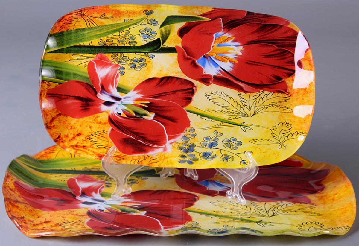 Набор блюд Olaff Цветы, 2 предмета. ZY-MD-TESE2-849ZY-MD-TESE2-849Набор Olaff Цветы состоит из двух прямоугольных блюд разных размеров. Блюдо, изготовленное из высококачественного стекла, оформлено рельефным краем и красочным изображением цветов.Такое блюдо сочетает в себе изысканный дизайн с максимальной функциональностью. Оригинальность оформления придется по вкусу тем, кто предпочитает утонченность и изящность. Красивое блюдо украсит сервировку вашего стола и подчеркнет прекрасный вкус хозяйки, а также станет отличным подарком.