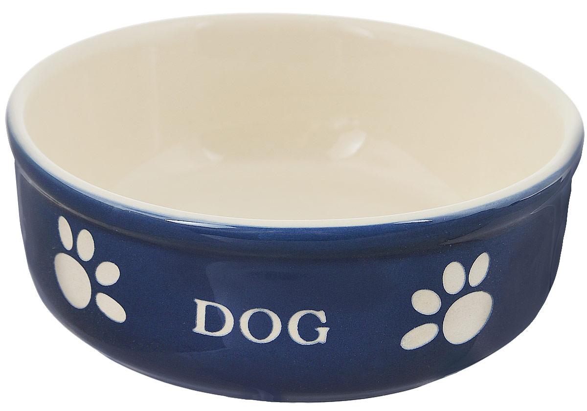 Миска для собак Nobby Dog, цвет: синий, светло-бежевый, 240 мл73318Миска для собак Nobby Dog выполнена из керамики, покрытой глазурью. Внешние стенки дополнены рельефными рисунками и надписями. Миска достаточно тяжелая, поэтому не будет скользить по полу. Отлично подойдет для собак мелких пород.Диаметр миски: 13,5 см. Высота миски: 5 см.