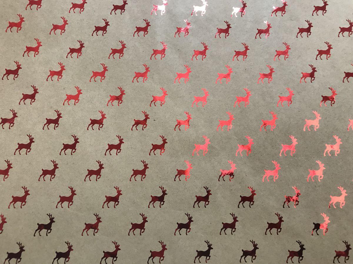 Крафт бумага Magic Time Красные олени, немелованная, 100 х 70 см76724Крафт бумага для сувенирной продукции Magic Time - это стильный и практичный вариант упаковки подарка. Авторский дизайн, красочное изображение, тематический рисунок - все слагаемые оригинального оформления подарка. Окружите близких людей вниманием и заботой, эффектно вручив презент в нарядном, праздничном оформлении.