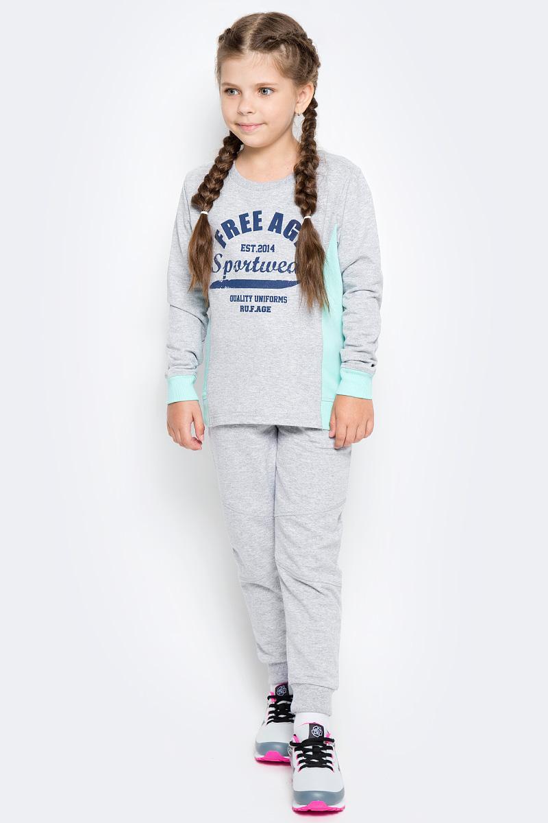 Брюки спортивные для девочки Free Age, цвет: серый меланж. ZG 10247-M-1. Размер 122, 6 летZG 10247-M-2Спортивные брюки для девочки Free Age идеально подойдут вашей малышке. Изготовленные из эластичного хлопка, они необычайно мягкие и приятные на ощупь, не сковывают движения ребенка и позволяют коже дышать, не раздражают даже самую нежную кожу. Модель с поясом из трикотажной резинки дополнена шнурком, который надежно фиксирует брюки и не сдавливает живот ребенка. Манжеты - из трикотажной резинки, имеются передние боковые карманы. Изделие оформлено принтовыми надписями.