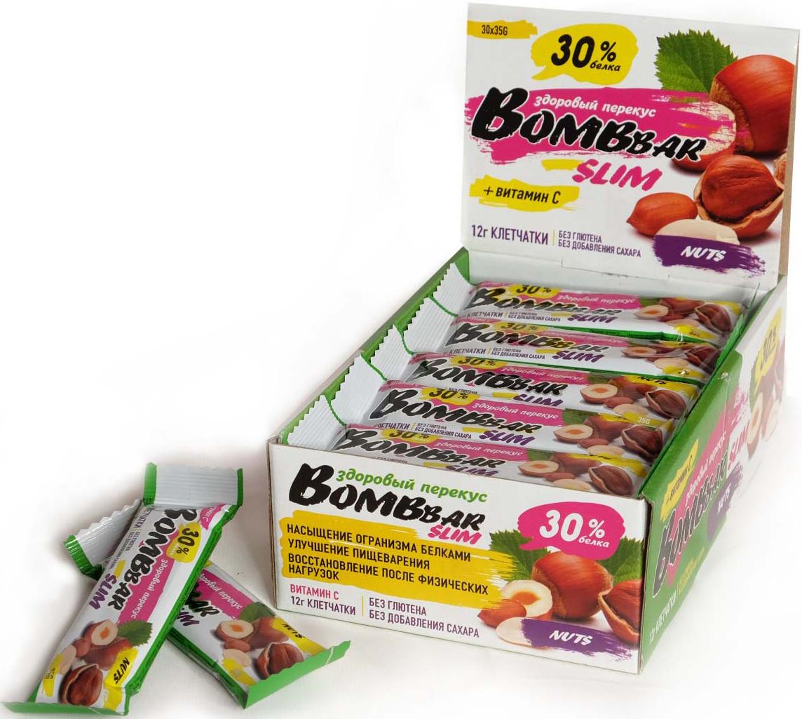 Батончик протеиновый Bombbar Slim, арахис и фундук, 30 шт x 35 г14620020960530Батончик протеиновый Bombbar Slim - натуральный продукт, поможет снизить вес, питает мышечную массу, придает эффект сытости, улучшает общее состояние системы пищеварения, способствует росту полезной микрофлоры, способствует подержанию здорового уровня сахара в крови. Не содержит сахар. Не содержит ГМО.Как повысить эффективность тренировок с помощью спортивного питания? Статья OZON Гид