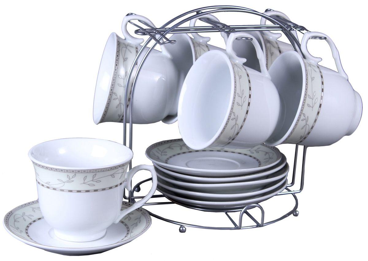Набор чайный Olaff, на подставке, 13 предметов. JDFS-12MS-002JDFS-12MS-002Набор Olaff состоит из шести чашек и шести блюдец изготовленных из высококачественного фарфора. Изделия расположены на металлической подставке. Набор оформлен стильным рисунком, декорирован серебром. Такой набор подходит для подачи чая.Изящный дизайн придется по вкусу и ценителям классики, и тем, кто предпочитает утонченность и изысканность. Он настроит на позитивный лад и подарит хорошее настроение с самого утра. Чайный набор Olaff - идеальный и необходимый подарок для вашего дома и для ваших друзей в праздники.