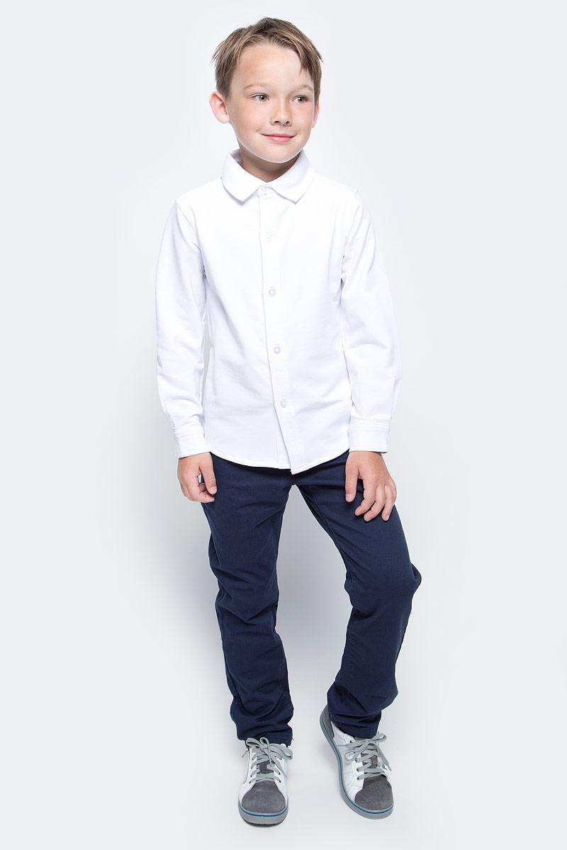 Рубашка для мальчика Vitacci, цвет: белый. 1173011-01. Размер 1281173011-01/1173011M-01Рубашка для мальчика выполнена из качественного материала. Модель с отложным воротником и длинными рукавами застегивается на пуговицы.