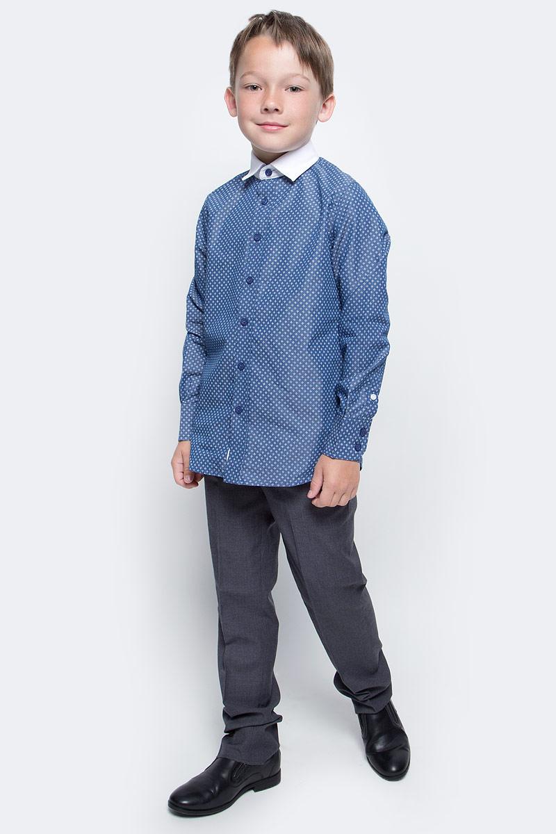 Рубашка для мальчика Gulliver, цвет: темно-синий. 217GSBC2307. Размер 134217GSBC2307Купить рубашку для мальчика - в преддверии учебного сезона, это самая распространенная задача родителей школьников. При всем богатстве выбора, купить рубашку высокого качества не очень просто. Школьная рубашка должна отлично выглядеть, хорошо сидеть, соответствовать актуальной форме, быть всегда свежей, выглаженной и опрятной. Именно поэтому состав, плотность и текстура материала имеют большое значение! Рубашка не нарушает школьный дресс-код, но делает повседневный Look ярче и интереснее, создавая позитивное настроение. Контрастная отделка: внутренняя часть планки и воротник придает модели выразительность и индивидуальность.