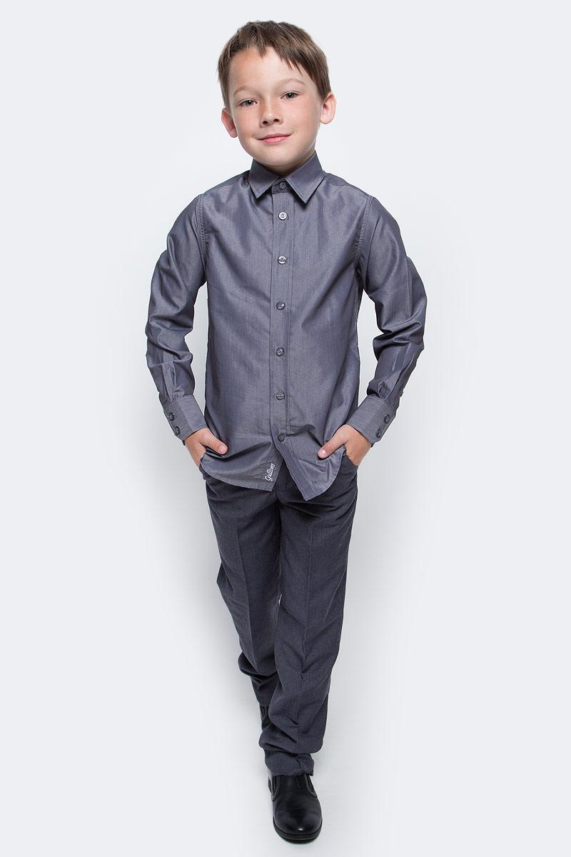 Рубашка для мальчика Gulliver, цвет: серый. 217GSBC2304. Размер 146217GSBC2304При всем богатстве выбора, купить рубашку для мальчика высокого качества не очень просто. Школьная рубашка должна отлично выглядеть, хорошо сидеть, соответствовать актуальной форме, быть всегда свежей, выглаженной и опрятной. Именно поэтому состав, плотность и текстура материала имеют большое значение! Хорошая школьная рубашка - достойное дополнение к костюму. Ребенок в ней - настоящий мужчина, с серьезным и ответственным подходом к делу. Рубашка от Gulliver - это качество, элегантность, комфорт, легкость в уходе.