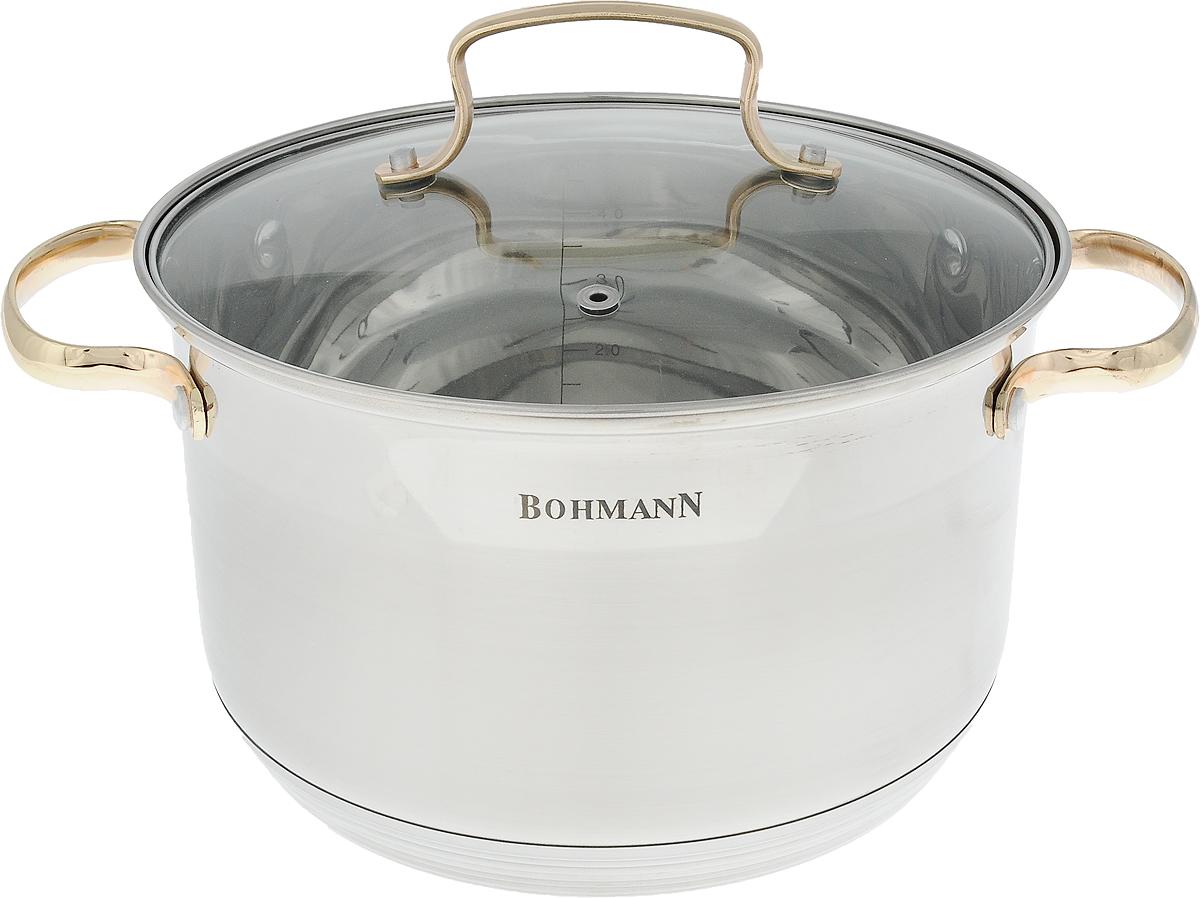 Кастрюля Bohmann с крышкой, 5 л. 1922BHG1922BHGКастрюля Bohmann изготовлена из высококачественной нержавеющей стали с внешней матовой и внутренней зеркальной полировкой. Нержавеющая сталь обладает высокой стойкостью к коррозии и кислотам. Прочность, долговечность и надежность этого материала, а также первоклассная обработка обеспечивают практически неограниченный запас прочности и неизменно привлекательный внешний вид. Кастрюля имеет многослойное капсульное дно с алюминиевым основанием, которое быстро и равномерно накапливает тепло и так же равномерно передает его пище. Капсульное дно позволяет готовить блюда с минимальным количеством воды и жира, сохраняя при этом вкусовые и питательные свойства продуктов. Применение технологии многослойного дна создает эффект удержания тепла - пища готовится и после отключения плиты благодаря термоаккумулирующим свойствам посуды. Посуда оснащена удобными металлическими ручками. Крышка выполнена из жаропрочного стекла, снабжена металлическим ободом и отверстием для выпуска пара. Внутренние стенки дополнены отметками литража. Можно использовать на газовых, электрических, галогеновых, стеклокерамических, индукционных плитах. Можно мыть в посудомоечной машине. Ширина (с учетом ручек): 30 см. УВАЖАЕМЫЕ КЛИЕНТЫ!Обращаем ваше внимание на тот факт, что объем кастрюли указан максимальный, с учетом полного наполнения до кромки. Шкала на внутренней стенке кастрюли имеет меньший литраж.