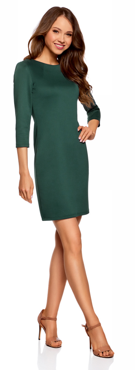 Платье oodji Ultra, цвет: темно-изумрудный. 14001105-5/45344/6E00N. Размер M (46)14001105-5/45344/6E00NКороткое элегантное платье oodji облегающего силуэта с рукавами 3/4. На спинке - небольшая молния. Вырез-лодочка красиво подчеркивает линию шеи и плеч. Рукава 3/4 визуально стройнят силуэт и акцентируют внимание на талии. Облегающее платье изящно подчеркивает изгибы фигуры, привлекает внимание к ногам и бедрам. Красивое короткое платье облегающего силуэта прекрасно подойдет для особенных случаев. В нем можно пойти на свидание, в кафе, кино или на встречу. Достаточно подобрать к платью подходящую случаю обувь и сумочку, и у вас готов эффектный наряд. В прохладные дни платье можно дополнить легким тренчем, жакетом или пальто. Это платье идеально подойдет для создания женственного и соблазнительного наряда. Красивое платье для утонченных особ!