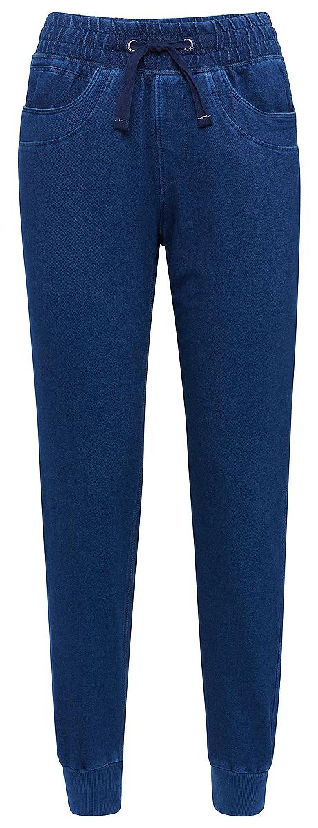 Брюки спортивные женские Tom Tailor, цвет: синий. 6855000.00.71_1053. Размер L (48)6855000.00.71_1053Спортивные брюки от Tom Tailor выполнены из эластичного хлопкового трикотажа. Модель с карманами на талии дополнена широкой эластичной резинкой и утягивается шнурком-кулиской, оформлена имитацией ширинки. Брючины понизу имеют широкие манжеты.