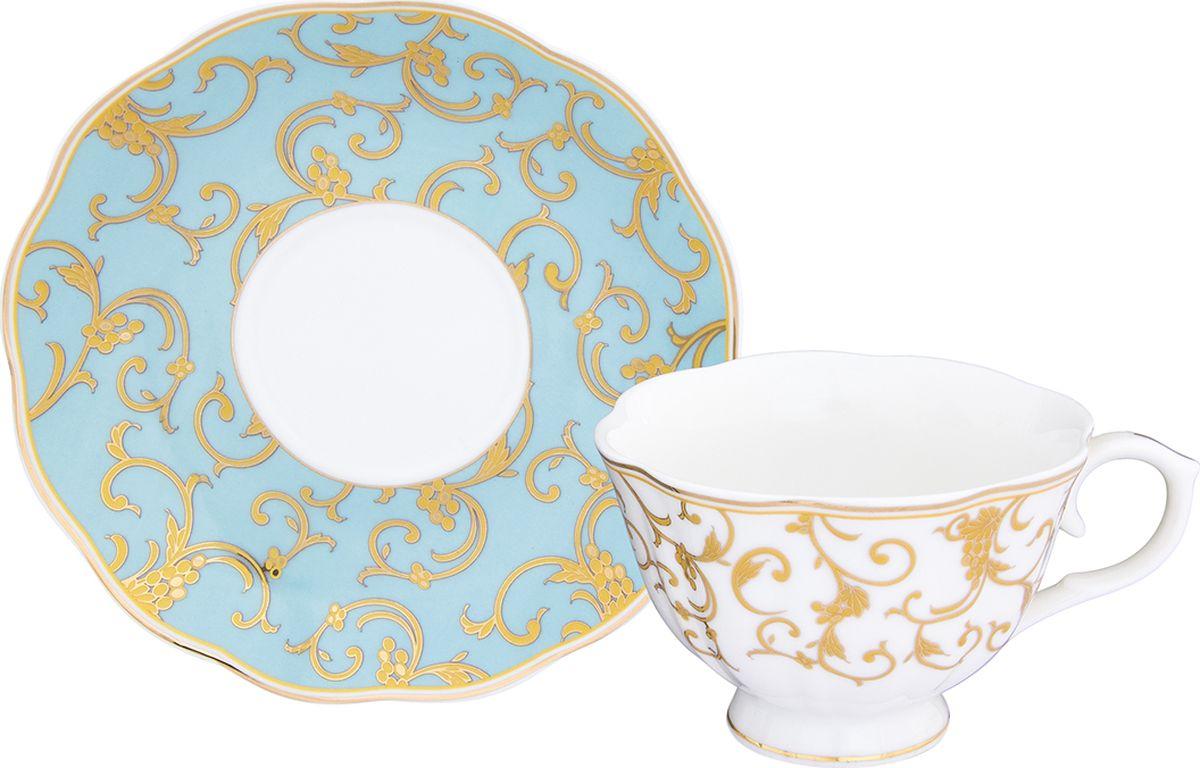 Чайная пара Elan Gallery Королевский узор на голубом чашка на ножке, 250 мл, 2 предмета. 504096504096Шикарная чайная пара на 1 персону - это отличный подарок, подходящий для любого повода. В комплекте 1 чашка на ножке объемом 250 мл, 1 блюдце. Изделие имеет подарочную упаковку, поэтому станет желанным подарком для Ваших близких!