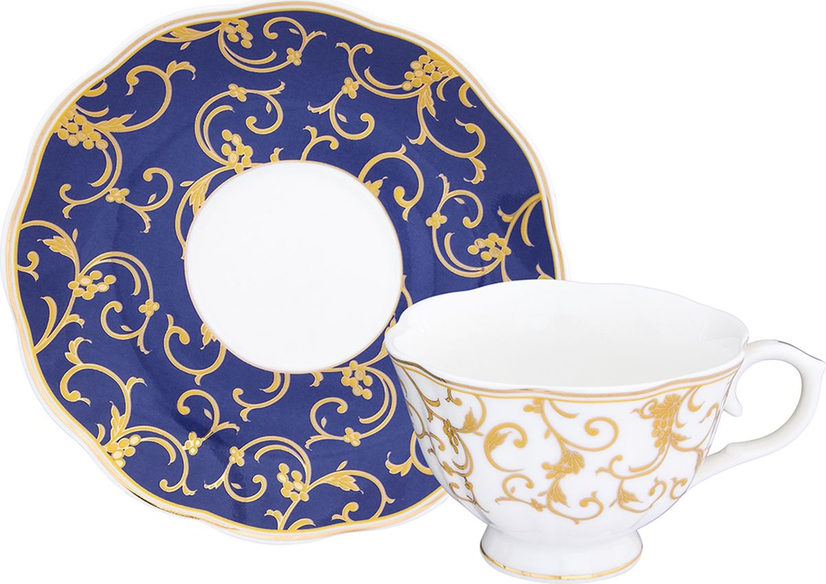 Чайная пара Elan Gallery Королевский узор на синем, 2 предмета504097Шикарная чайная пара на 1 персону - это отличный подарок, подходящий для любого повода. В комплекте 1 чашка на ножке объемом 250 мл, 1 блюдце. Изделие имеет подарочную упаковку, поэтому станет желанным подарком для ваших близких!