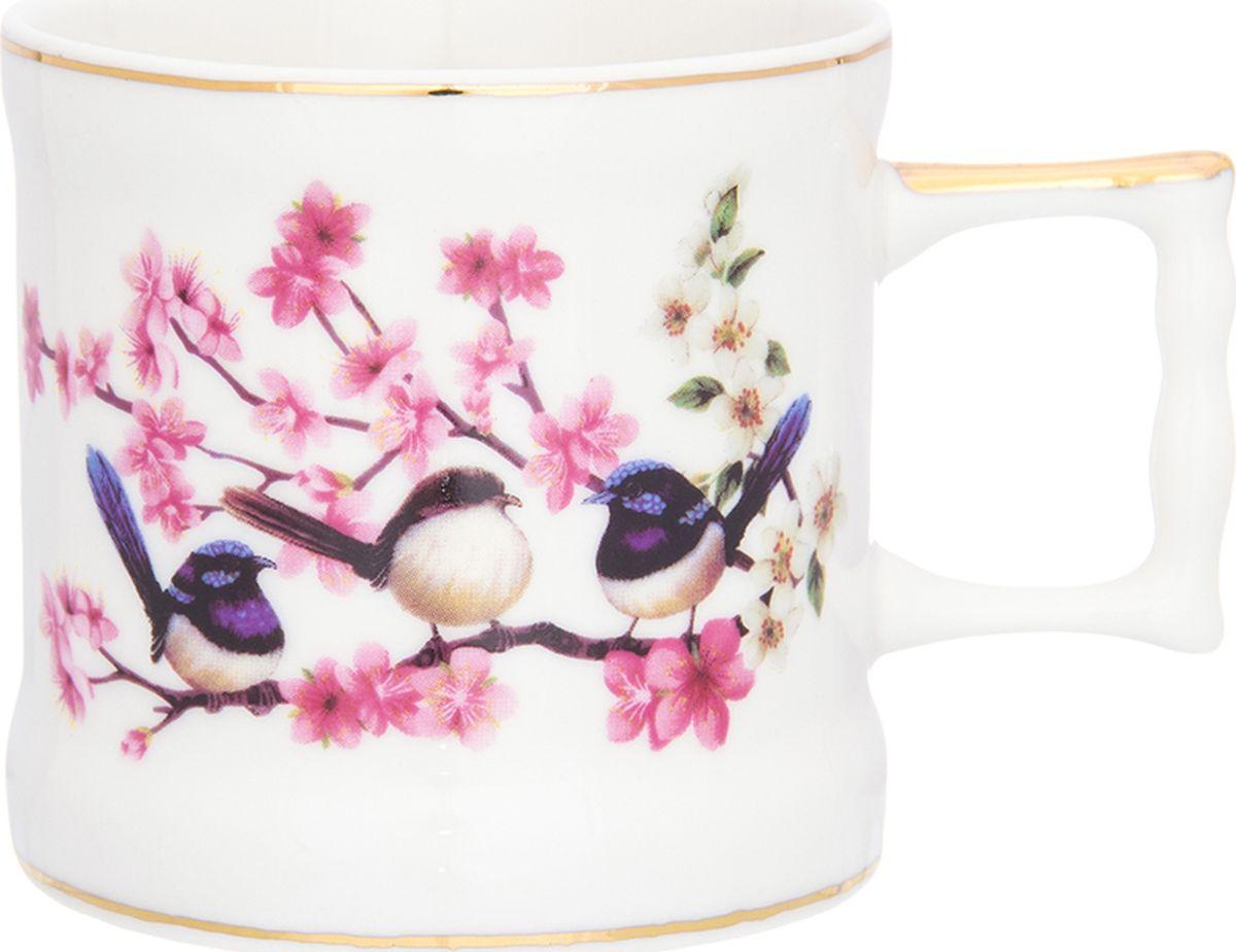 Кружка Elan Gallery Райские птички, 175 мл. 504115504115Кружка станет отличным дополнением к сервировке семейного стола и замечательным подарком для ваших родных и друзей. Размер 10х7,3х6,5 см. Объем 175 мл.